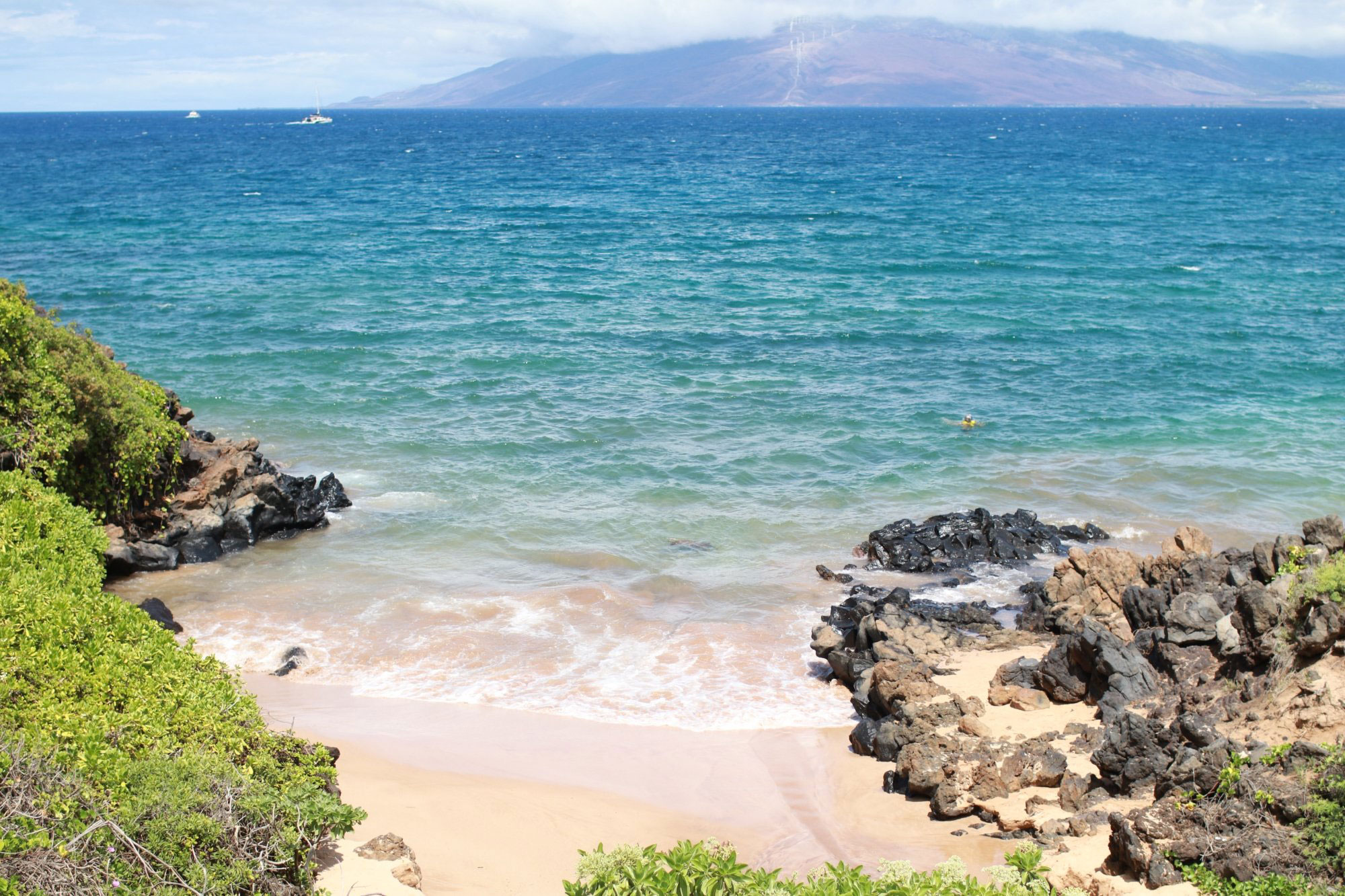 Tucked in a curve of Maui's coastline, this impossibly lovely spot is bordered by some of the most luxurious resorts on the island. Never fear: The beach is public, and sunbathing is absolutely free.