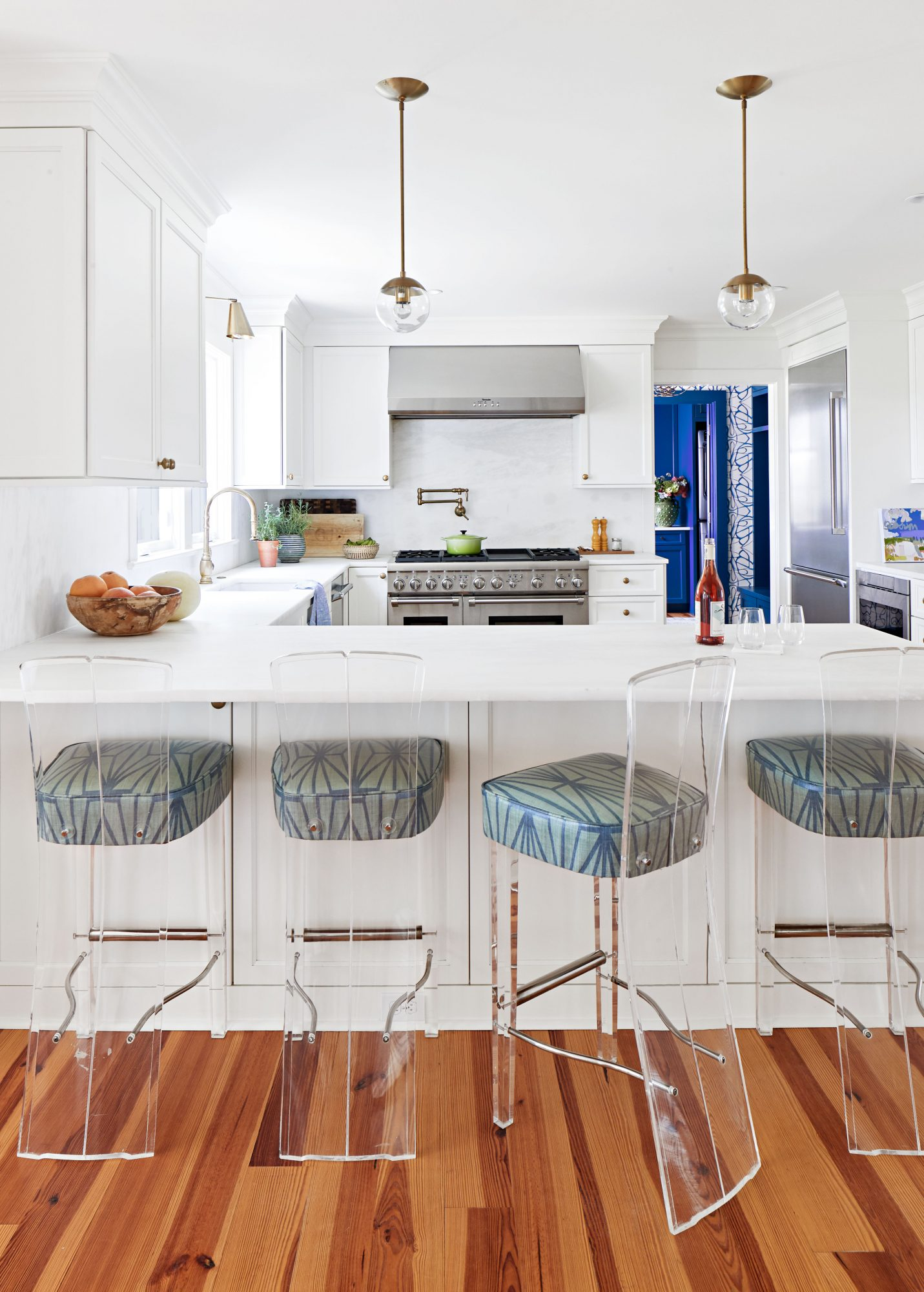 Airy White kitchen with lucite barstools