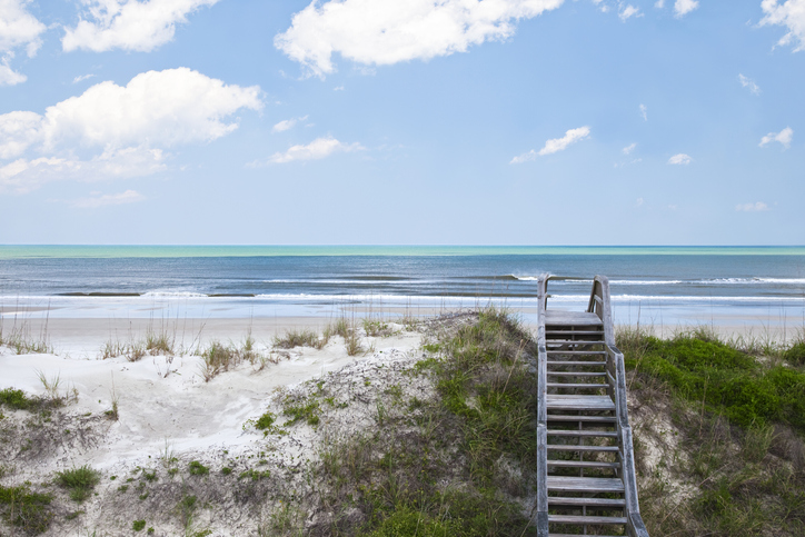 "Boardwalk crossing over sand dune leading too the beach of the south atlantic ocean at ""crescent beach"" St.Augustine FL"
