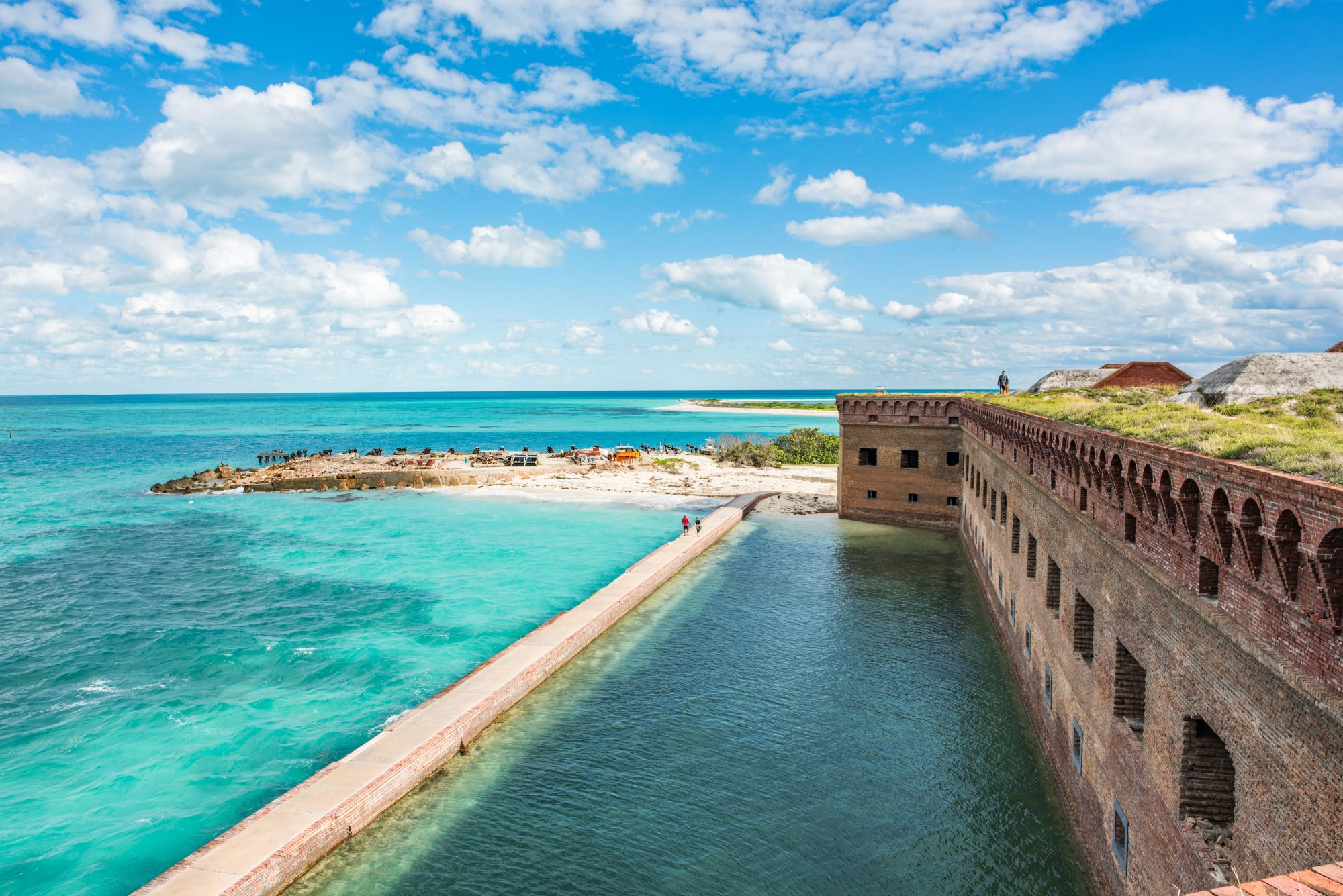 The ultimate snorkeling getaway lies 70 miles off Key West at Dry Tortugas National Park, which is only accessible by ferry or seaplane. Snorkeling the crystal-clear waters around the historic fort makes for the perfect day trip, and camping at historic Fort Jefferson allows for a number of unique adventures underwater, even night snorkeling.