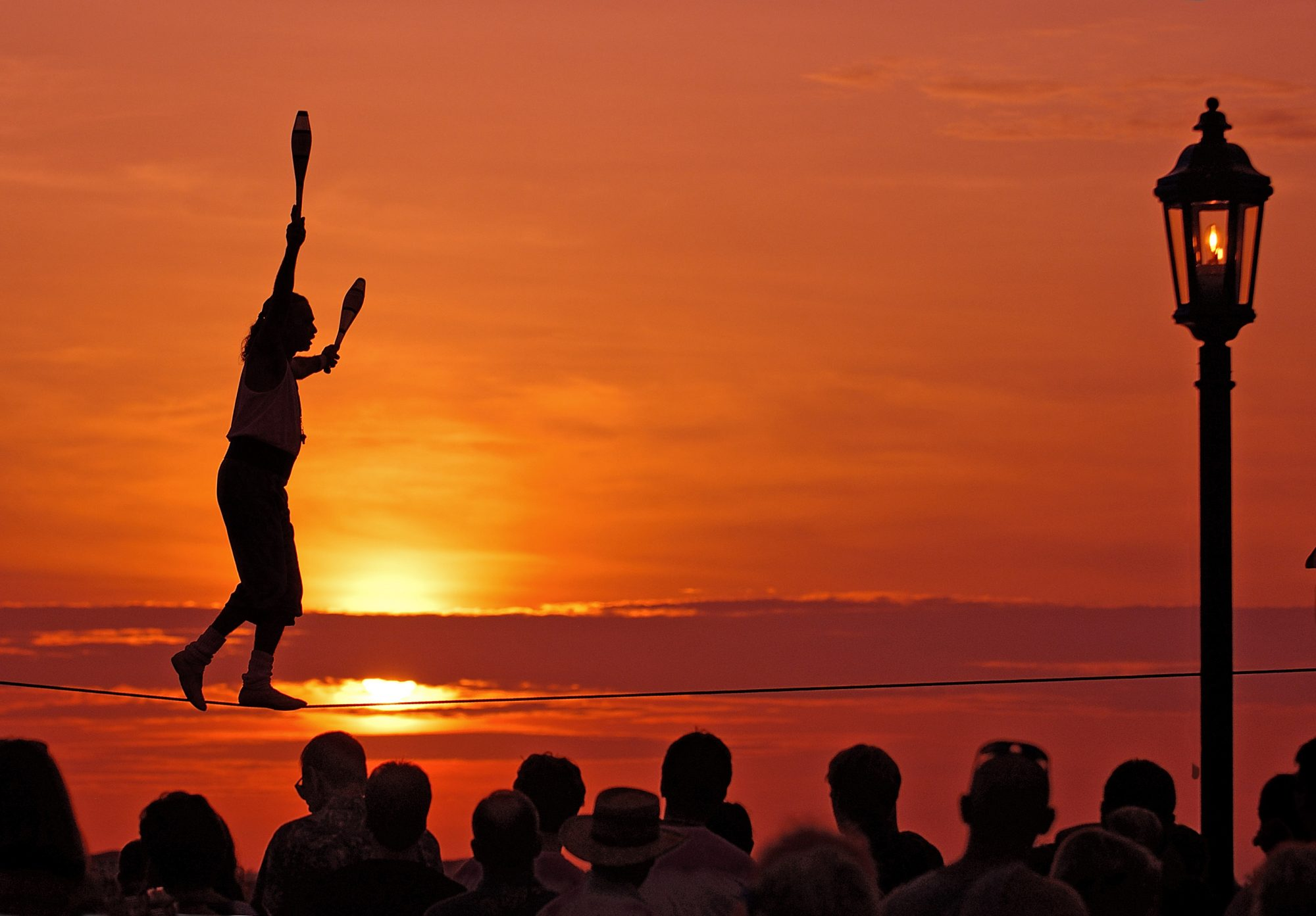 Join the crowds at Mallory Square for a nightly sunset celebration. As the sun sinks into the sea, you'll find acrobats, guitarists, sword swallowers and entertainers like Will Soto performing his juggling high wire act.