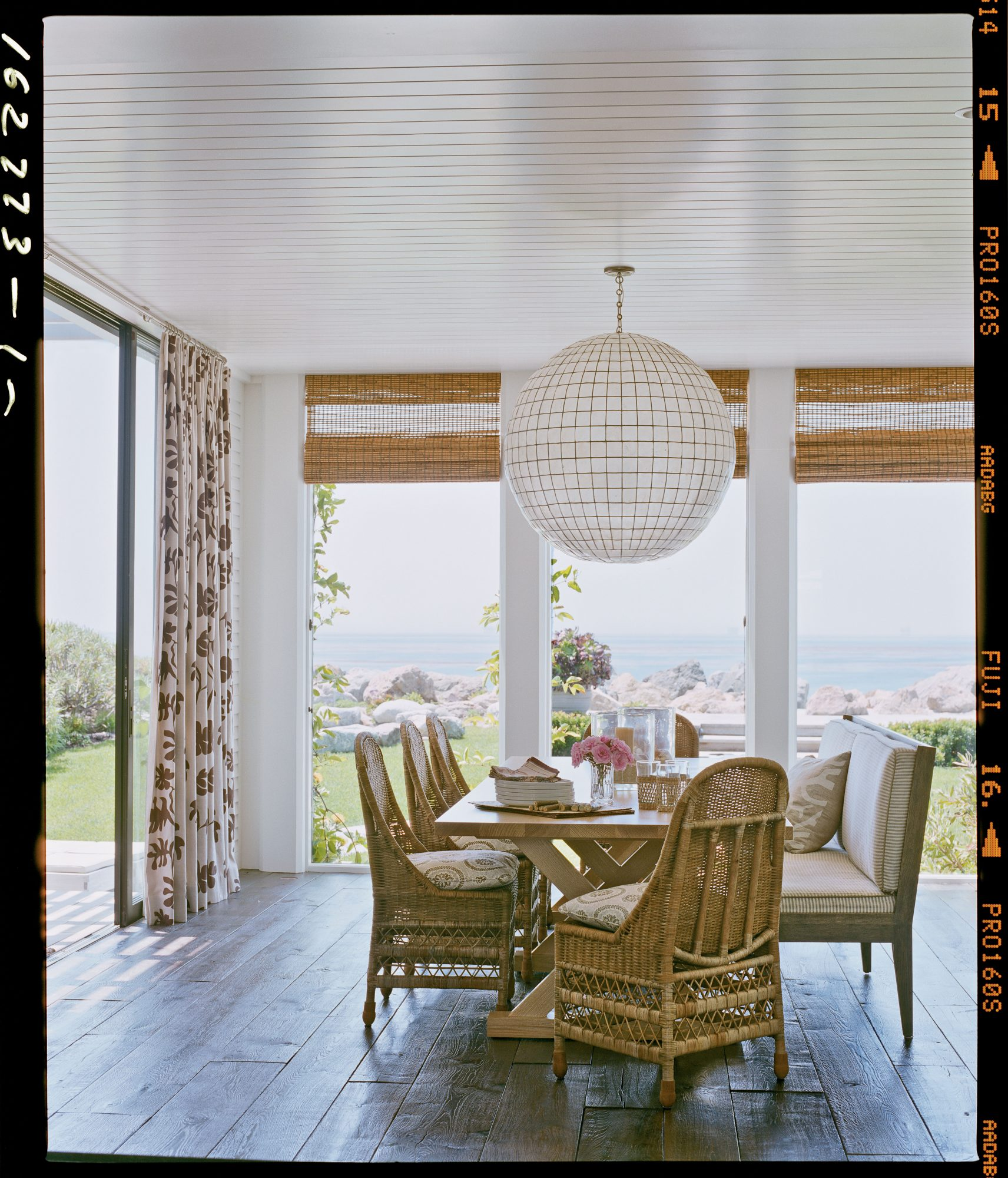 Make a statement with your lighting like these homeowners did with this 36-inch capiz shell orb over their low-key dining room table. Not only does it cast a warm glow over diners, but also it can be spotted from the shore and gives this beach bungalow a one-of-a-kind look.