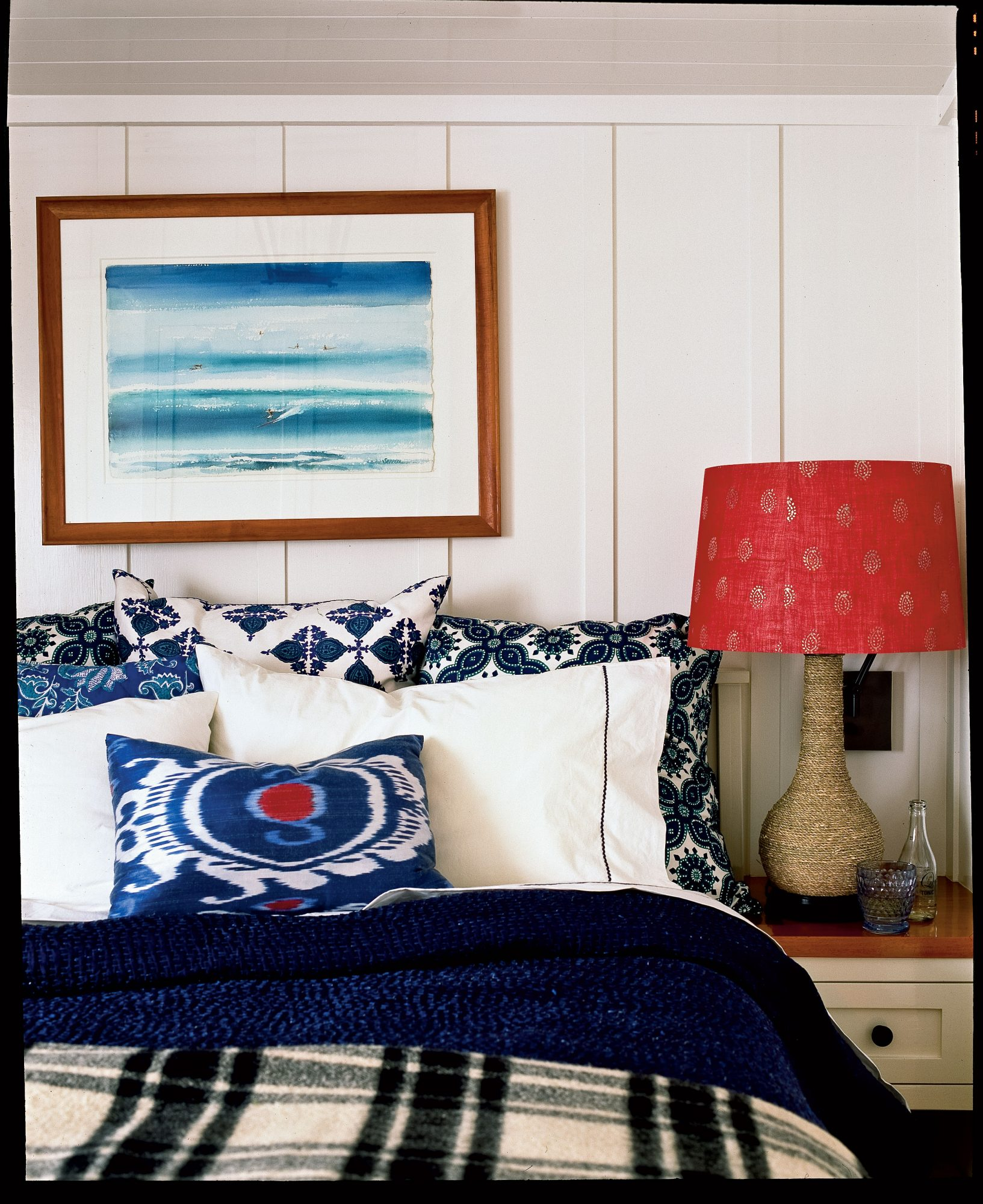 A John Severson watercolor painting of Waikiki Beach hangs above the built-in bed to bring the coast in to the master bedroom.
