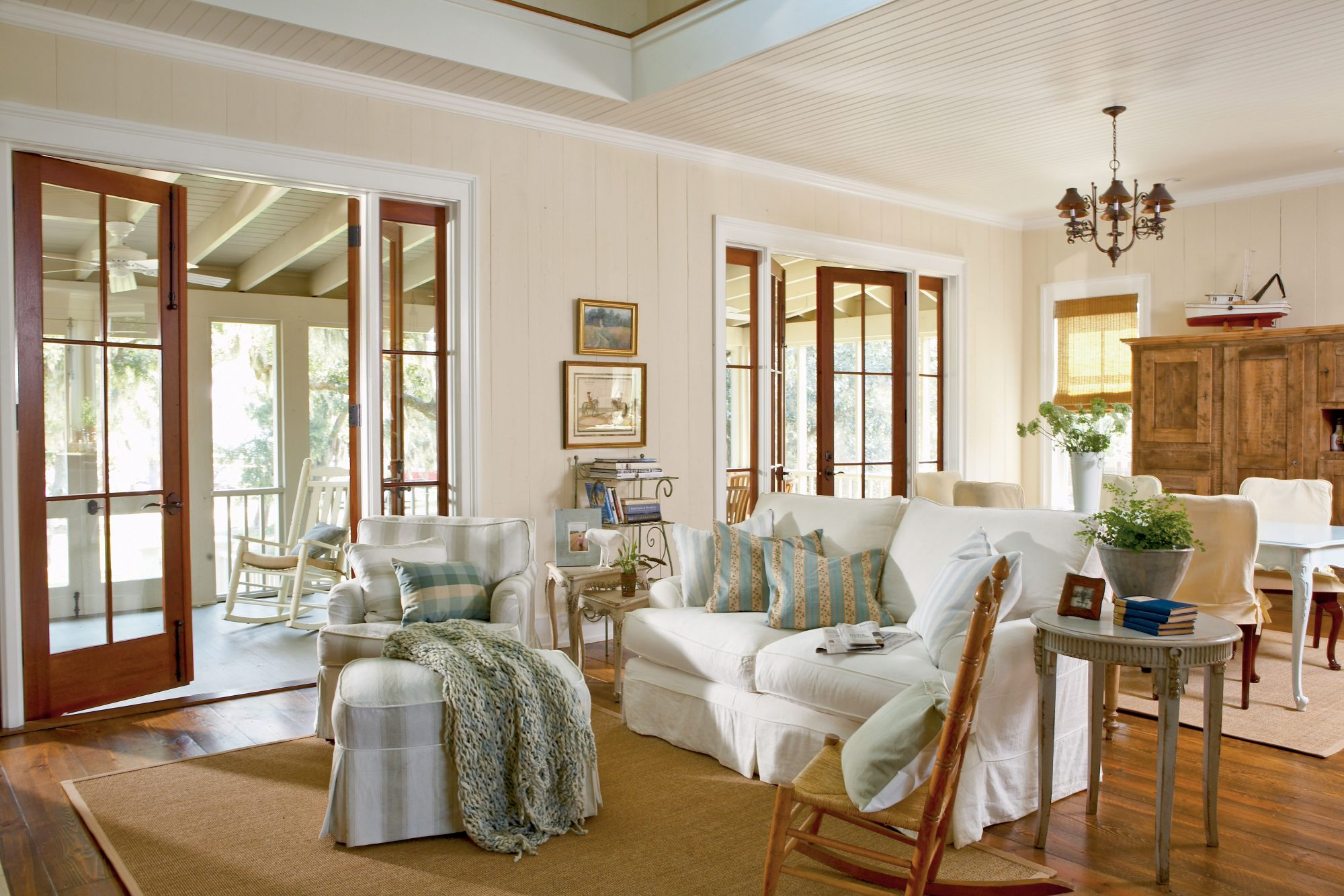 Cypress wood walls, rocking chairs, and muted colors enhance the homey feel.