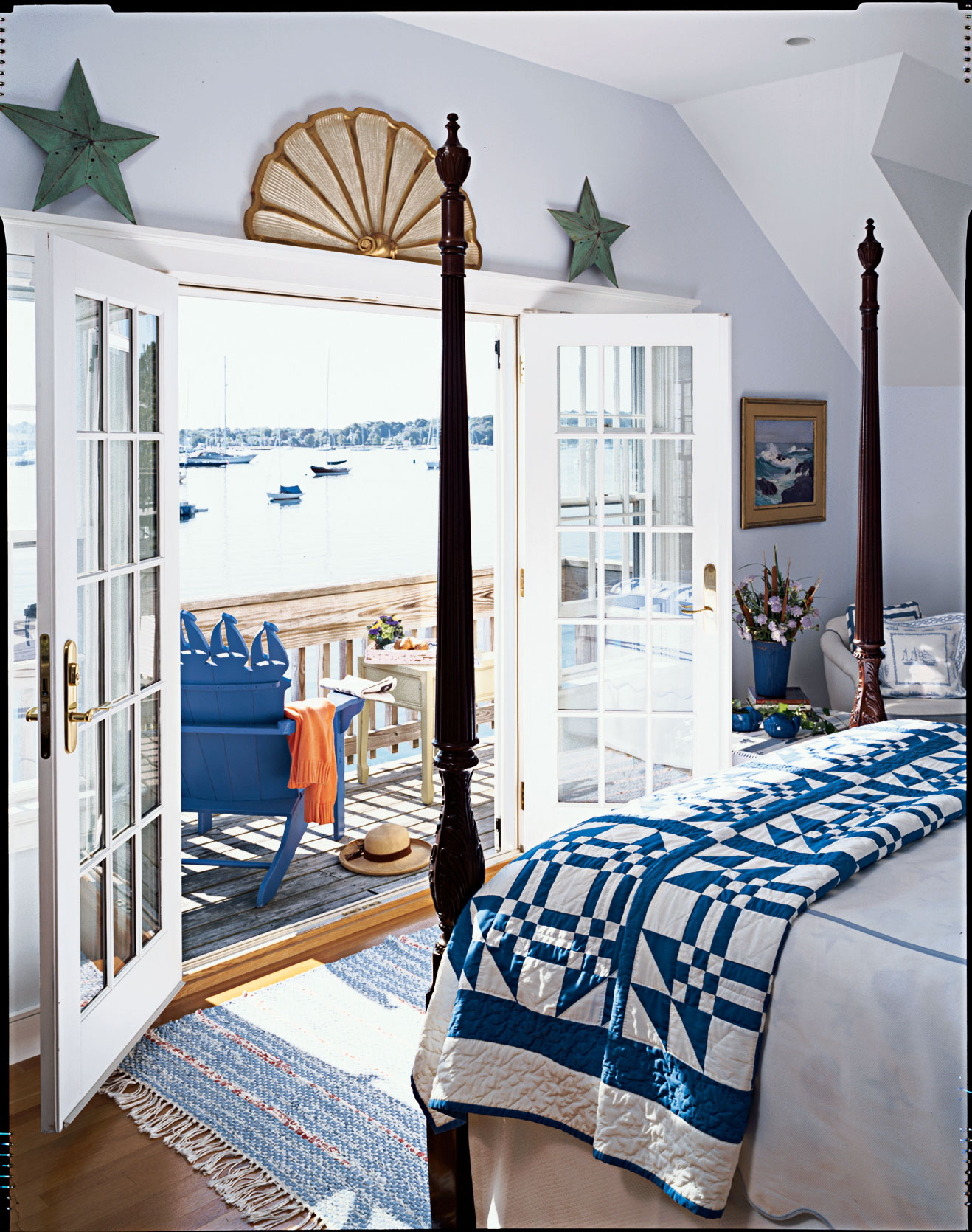 Nothing is more classically coastal than a blue-and-white color palette. The bright white provides the perfect base for deep blue accents, resulting in a crisp combo that's always right on trend. On the coast, throw open glass French doors to infuse your space with the salty breeze.