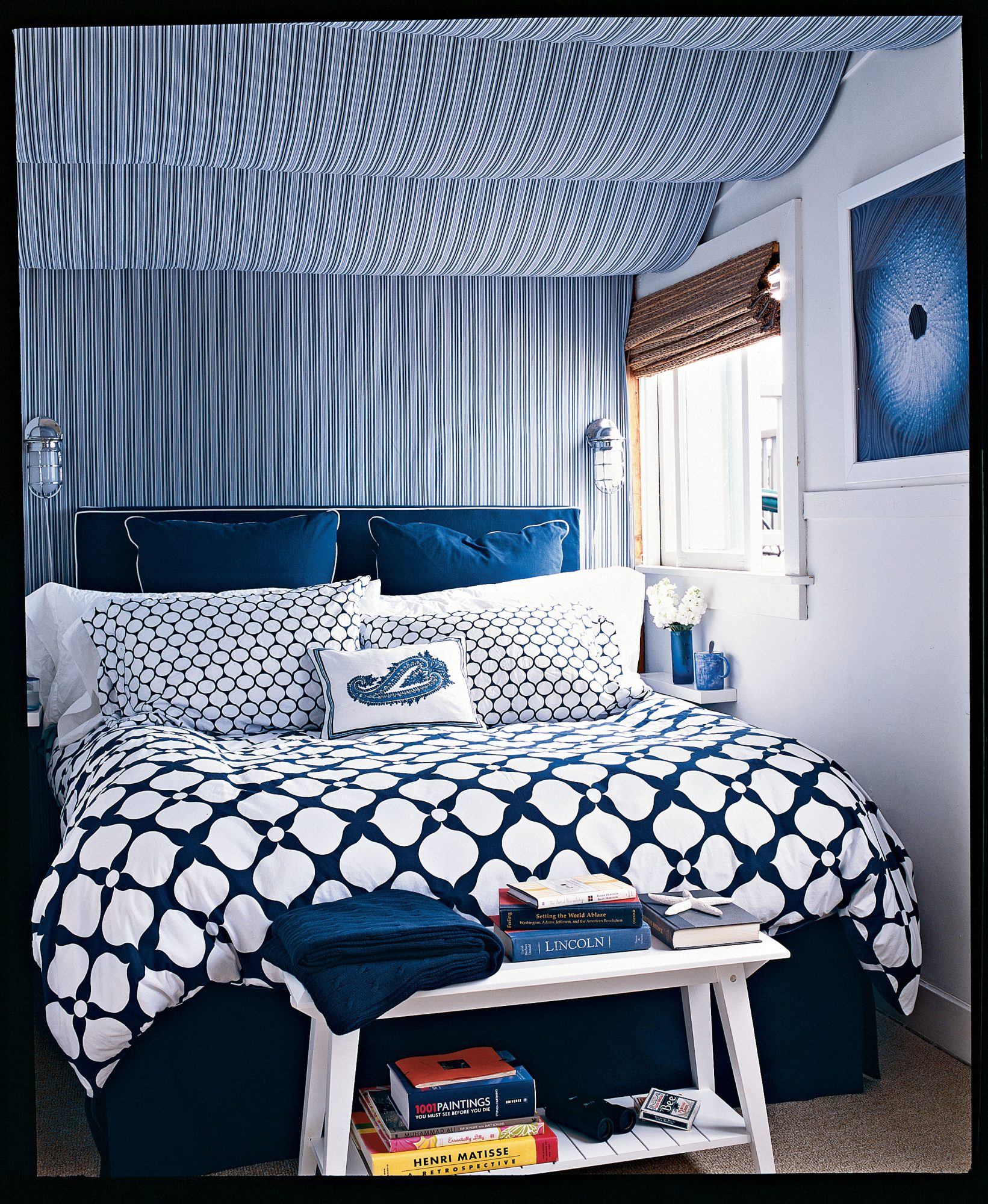 This teeny bedroom leaves just enough room for the bed and bench, but it seems so much larger thanks to its diverse mix of patterns and prints. You can put stripes with spots—and add much-needed dimension—as long as you simplify your palette.