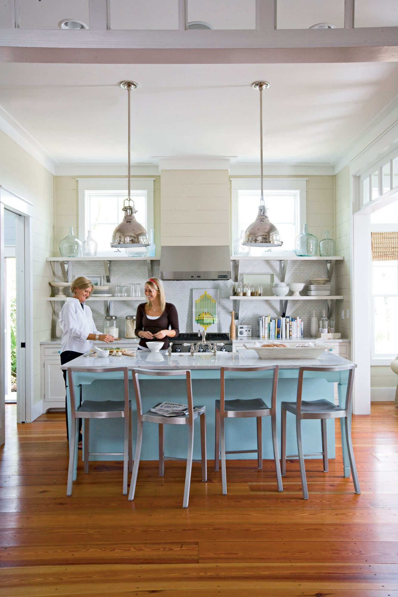 Open shelving puts your kitchen accessories on display, but keep them in the same color family for a major style boost. A painted island adds a splash of color.