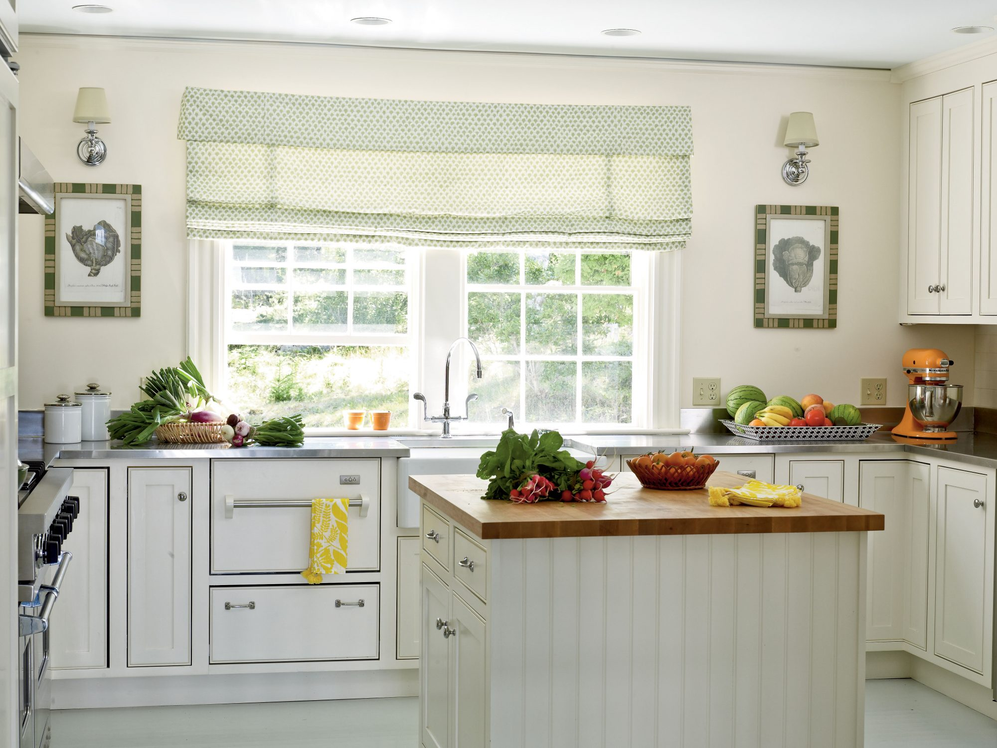When you know you're going to be working overtime in the kitchen, simplify the design and let efficiency be your guide. A colorful mixer and a bright dish towel add cheerful color to this neutral space. Such details as twin sconces lend charm.