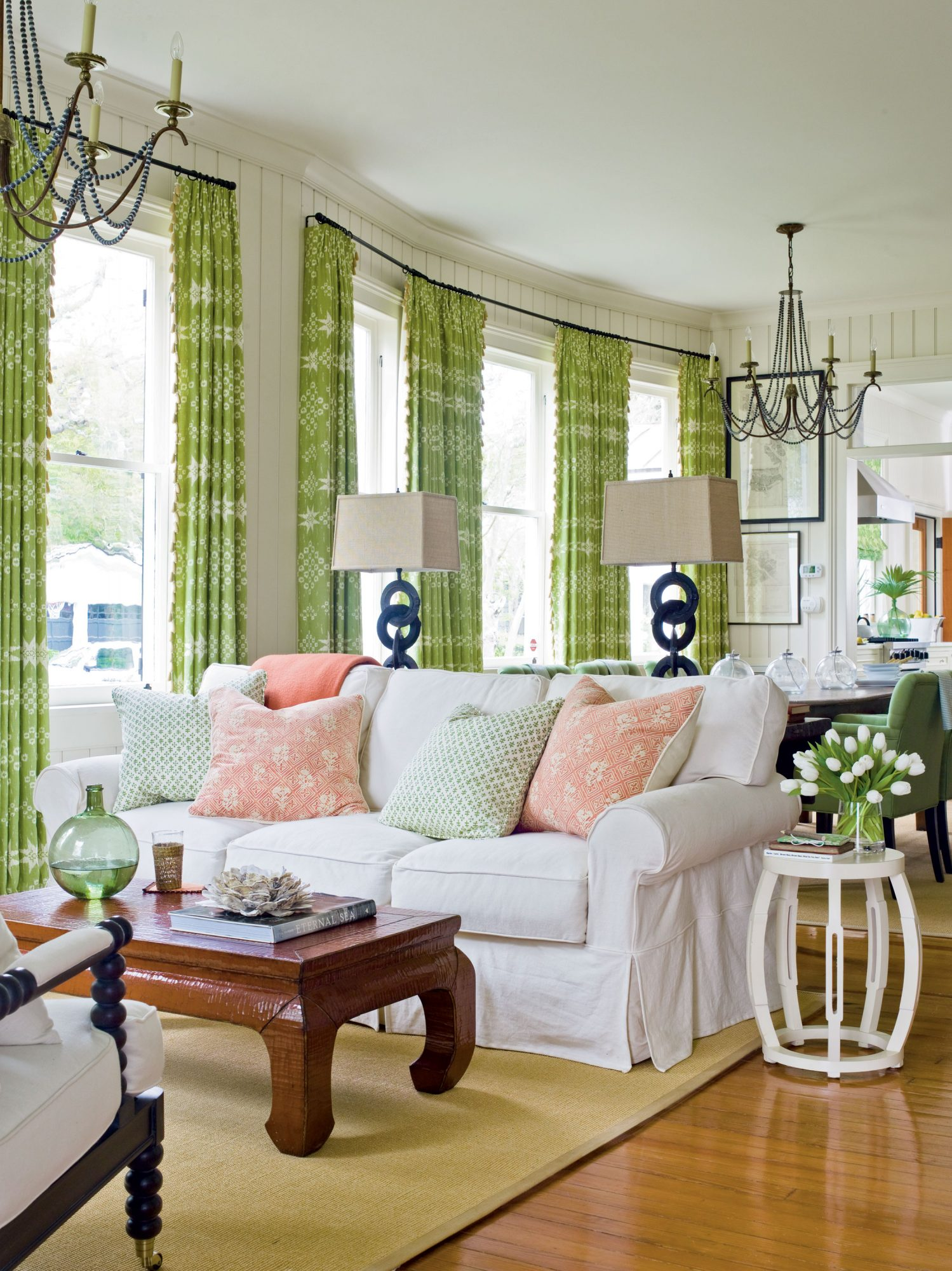 Invigorate your living area with a serious splash of color and fun details such as these iron lamps. The decor lets guests know to get ready for a good time, but it's the comfy couch that gets them to stay awhile.