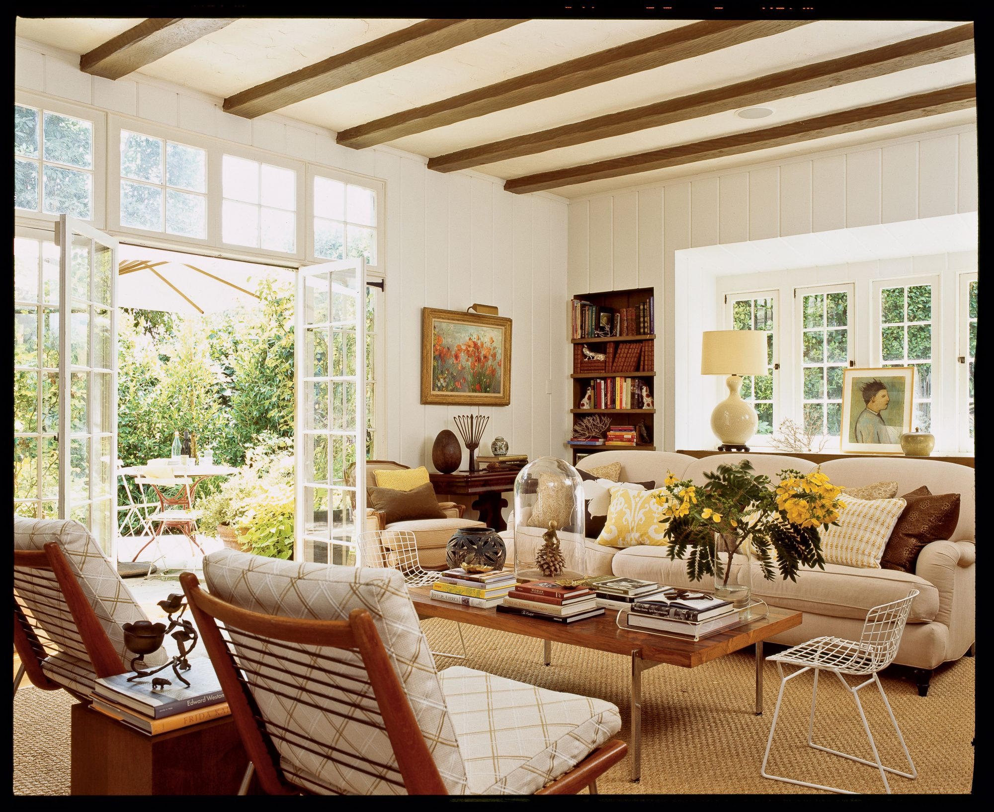 Give your home a lived-in look for a welcoming feel using kid-friendly seating, covering your tabletops with books and curios, and letting in some sunshine.