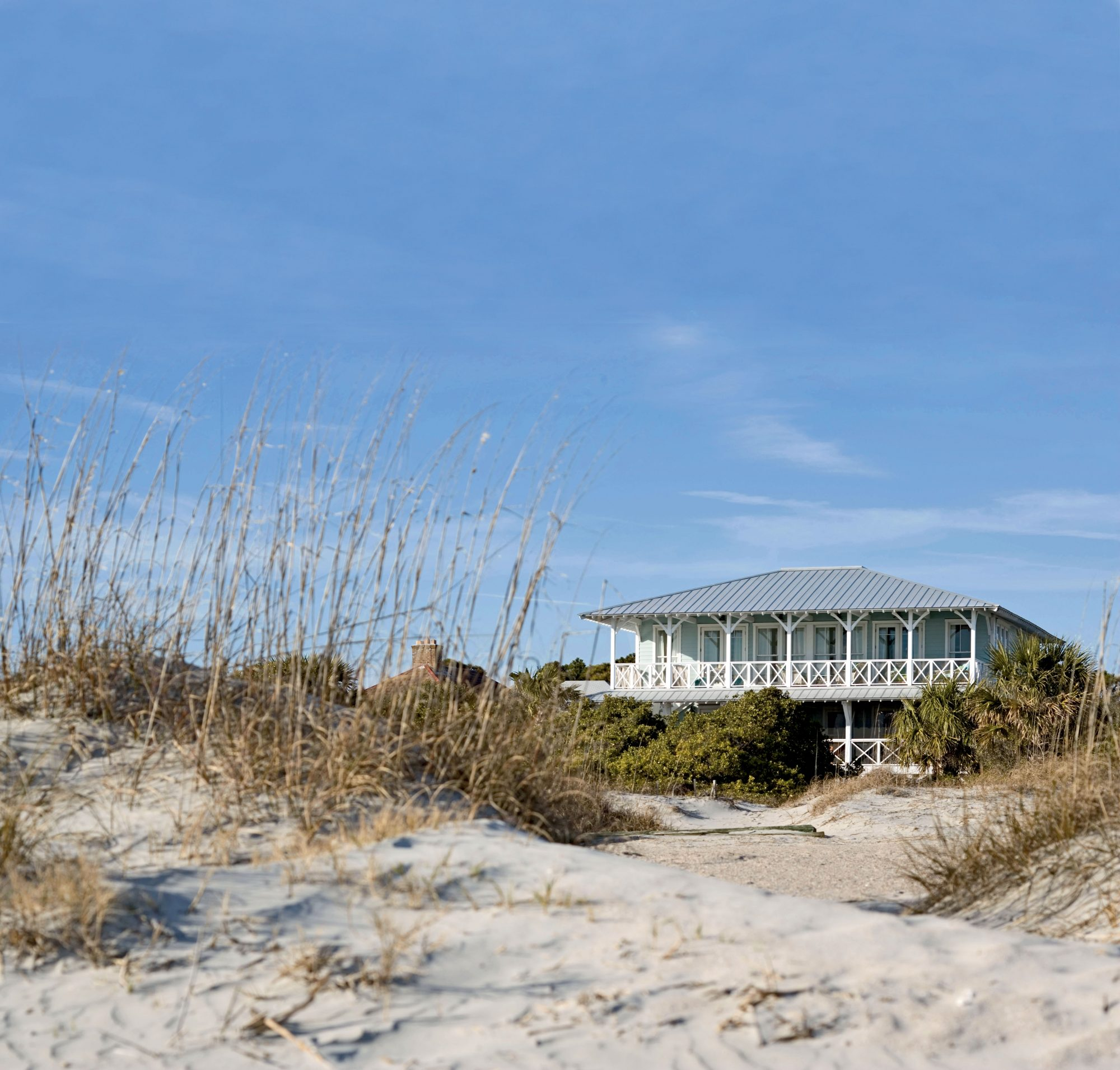 "Stella and Dave Peterson's coastal Georgia vacation home has all the classic details—broad porches, exposed rafter tails—of a century-old house. But it was only built to look that way. ""I'm an old-house person, but I've realized you can build character into new construction and create your own history,"" Stella says."
