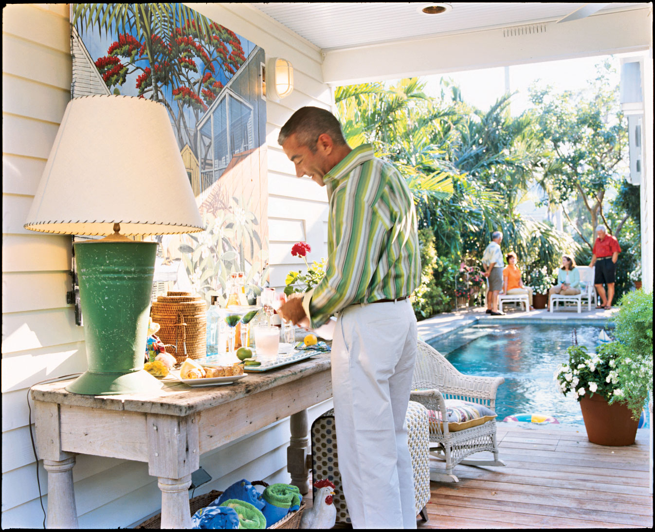 A poolside bar invites guests outside. A painting by Key West artist Rick Worth, created with automobile paint, can withstand the elements.