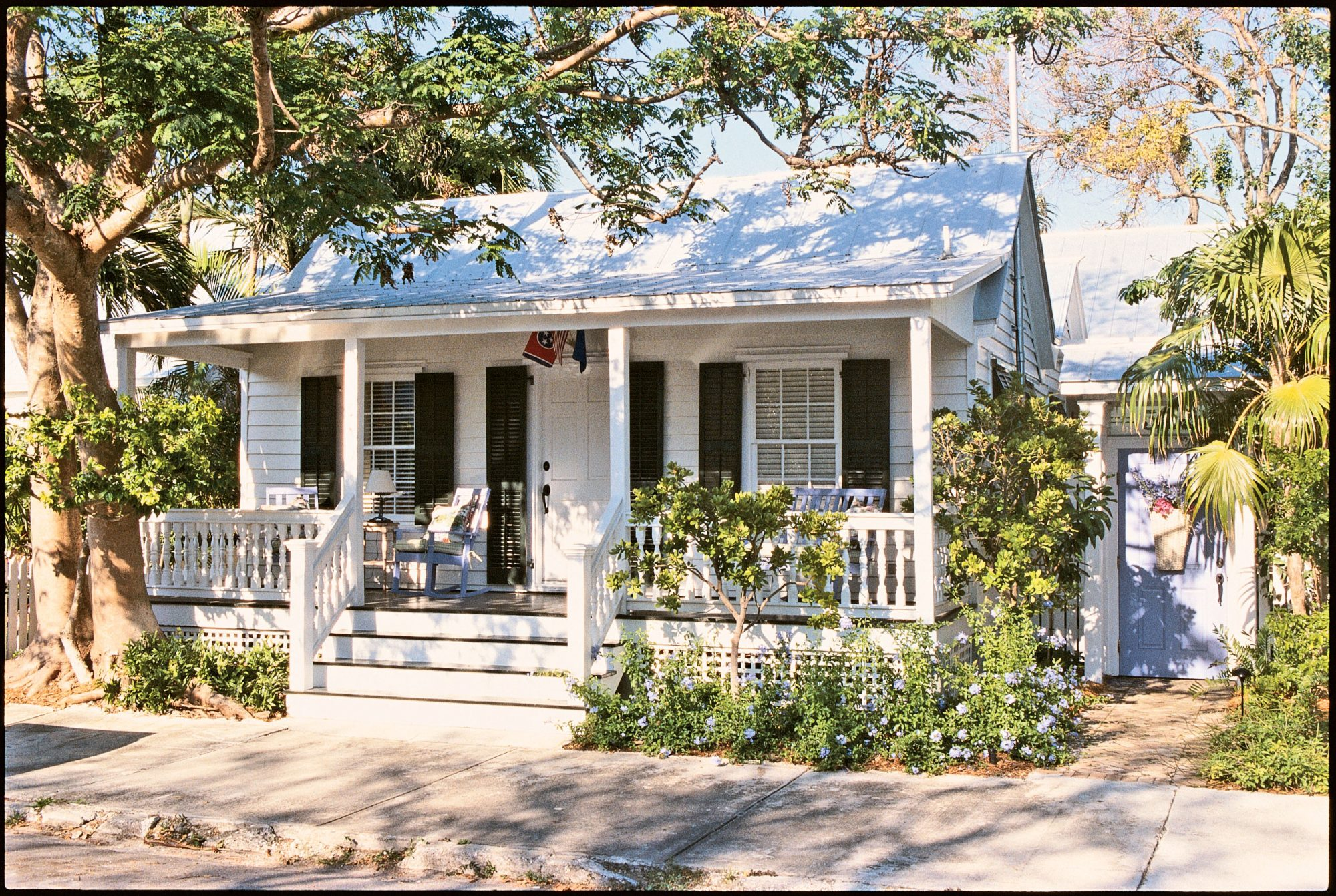 Candice and Marty Carr's clapboard getaway cottage in Key West was built at the end of the 19th century. A 1980s addition gave it the sawtooth roofline, with parallel gables that create a zigzag appearance. On the inside, it's clear that laid-back is the attitude of choice in this home.