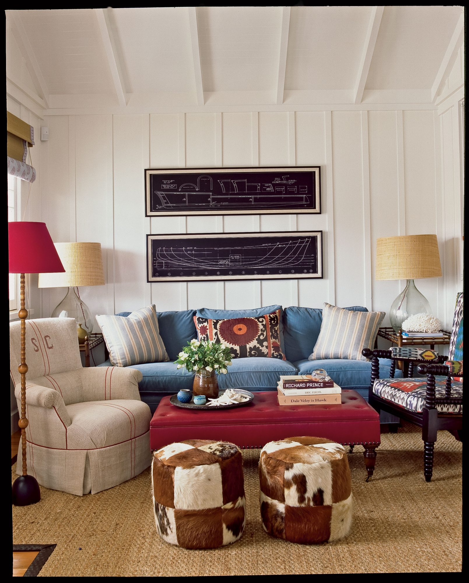 The living room was decorated with generous upholstered pieces to ensure maximum comfort. The corduroy, leather, and vintage grain sack upholstery encourages lounging, while batik prints in rich reds and marine blues provide an exotic beat.