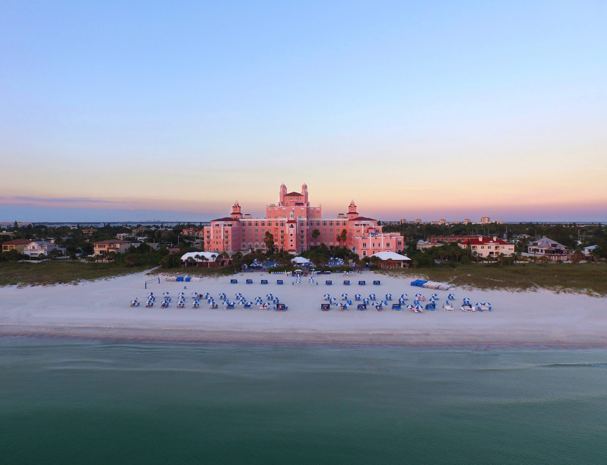 """Reminiscent of a Mediterranean-style castle with its coral pink exterior and striking architecture, The Don CeSar towers over St. Pete Beach like a crown jewel. Known as Florida's iconic """"Pink Palace,"""" the hotel opened at the height of the Great Gatsby era in 1928. Go hunting for shells on the powdery white-sand beach, take a banana boat ride in the warm waters of the Gulf of Mexico, and then head to Uncle Andy's Ice Cream Parlor where you'll find nostalgic treats and homemade ice cream. 3400 Gulf Boulevard, St. Pete Beach, FL 33706"""