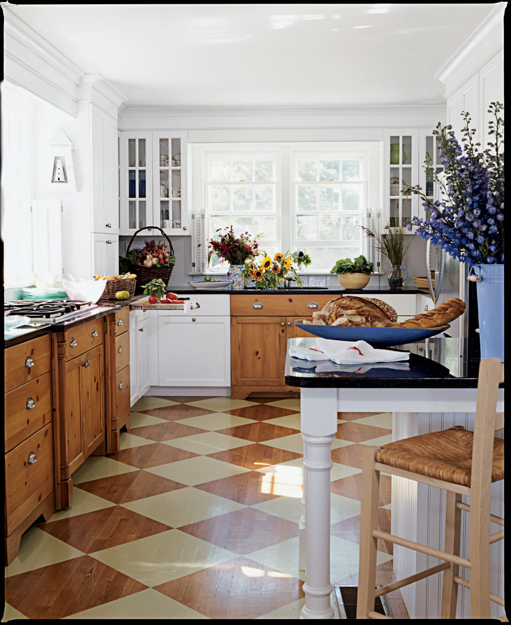 "The green squares faux painted diagonally on the floors add a touch of whimsy. ""I wanted to inject some color beneath your feet,"" the homeowner says. ""This was the perfect solution."""