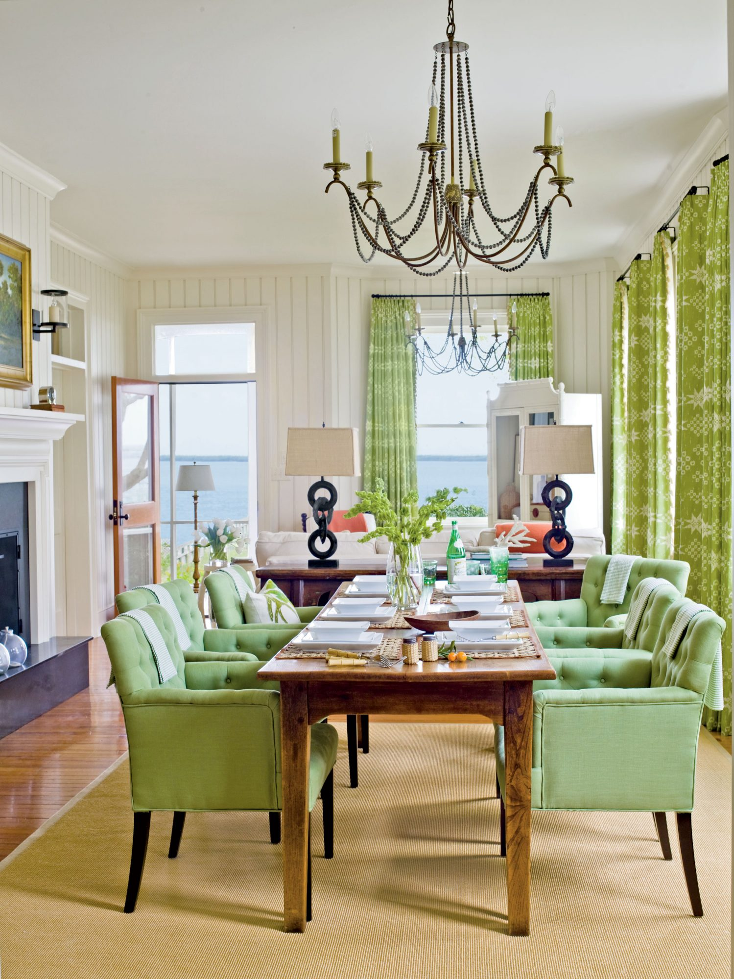 The living and dining room areas were enlivened with punches of green and coral. Coastal accents—sea grass rugs, coral pieces, bamboo flatware—are scattered throughout to reflect South Carolina's beach-loving lifestyle.