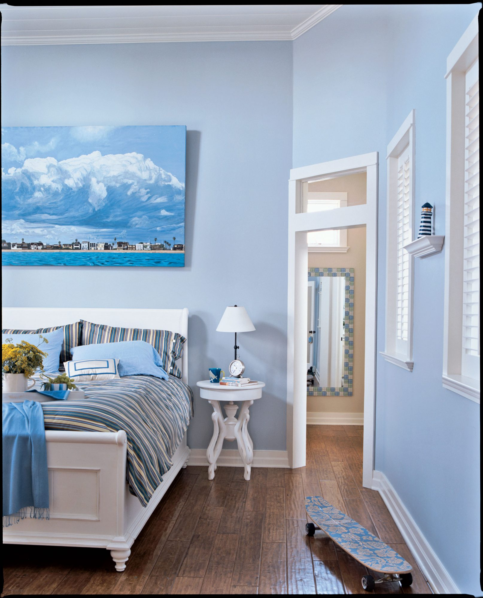 """When the guests go home, the homeowners retire to their soothing blue master suite. """"It's like we're waking up in the clouds every morning,"""" they say."""