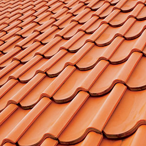 Colorful clay barrel tiles are a popular choice for Mediterranean-, Italian-, and Spanish-style homes in Florida and Southern California. Both fire and water resistant, the tiles usually require minimal maintenance, such as routine debris removal.