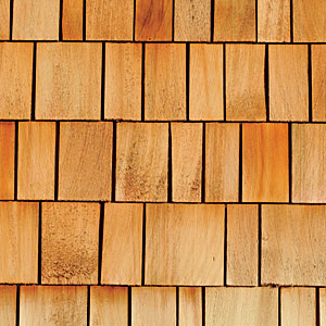 With their dark blonde to chocolate brown hues, Western red cedar shingles possess a natural beauty, making them popular along the New England coast. It's also a durable, impact-resistant material.