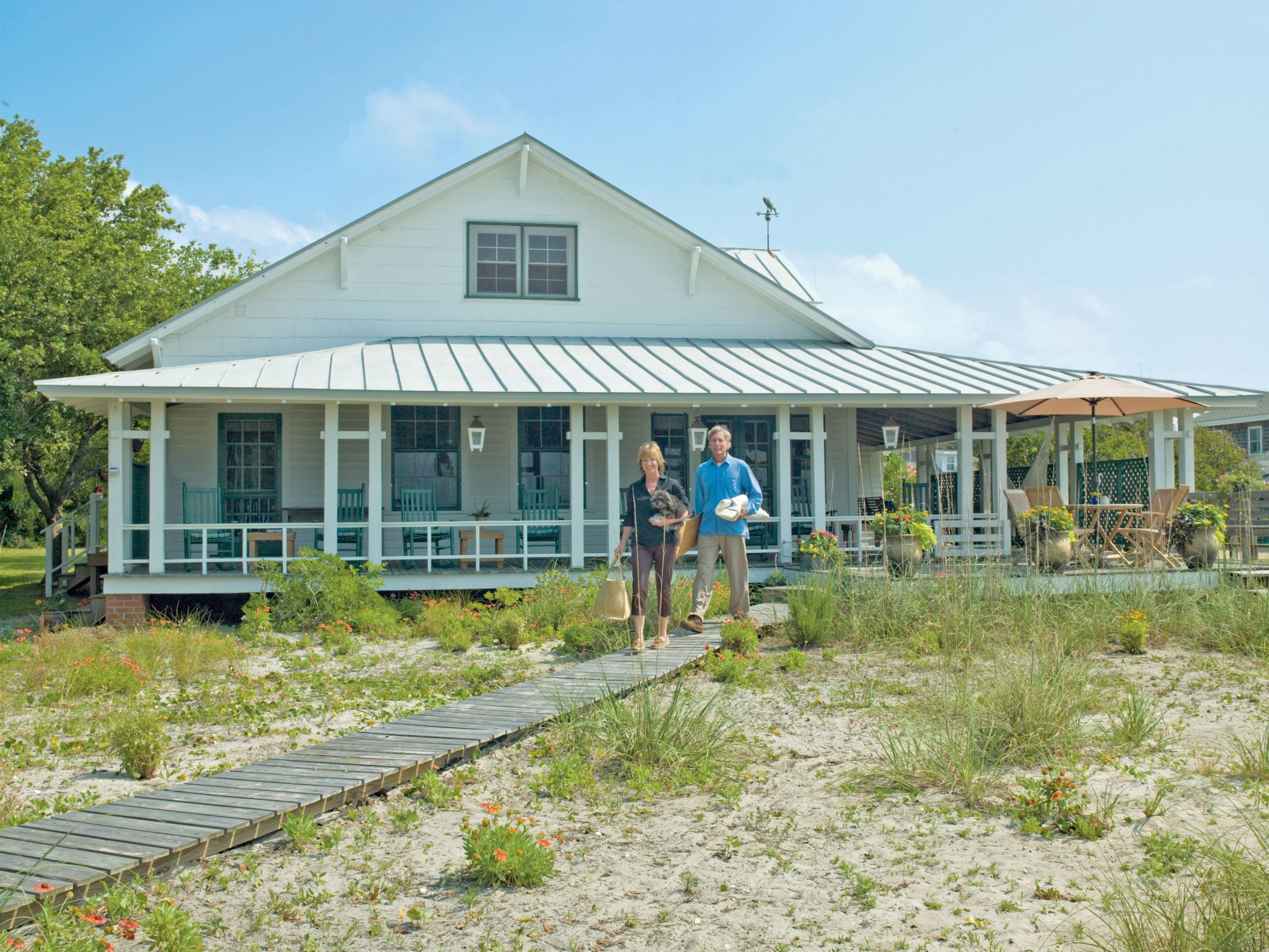 A North Carolina couple learned to live with—and play up—their cottage's quirky charms in Morehead City. While planning a renovation, Catherine and Mason Williams grew attached to the small 1914 cottage and decided not to make any additions but to optimize every inch of the 1,350 square feet. That's where the couple's four years of living on a 53-foot Ketch sailing yacht came in handy.