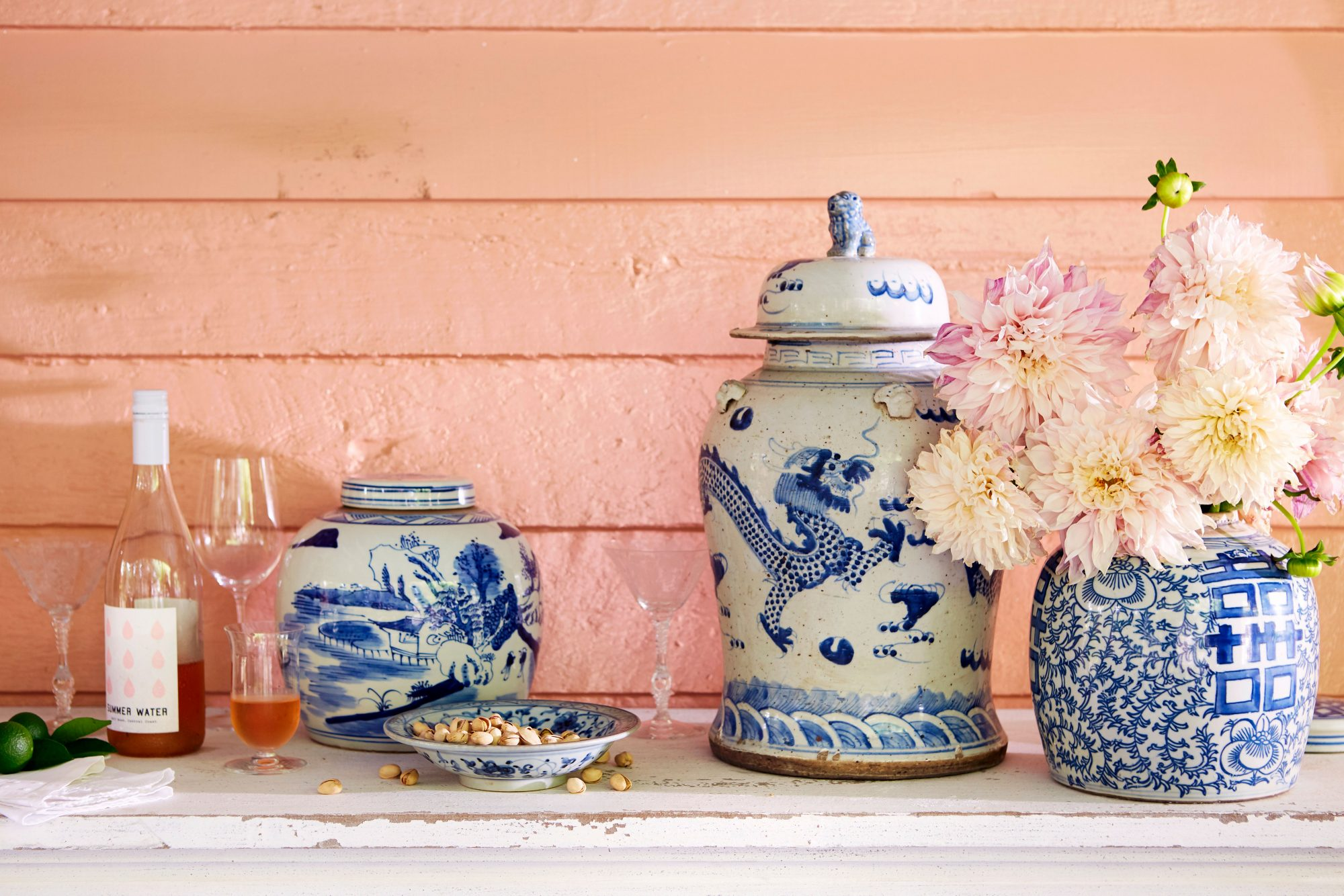 Pink Wall with Blue and White Ginger Jars Filled with Peonies