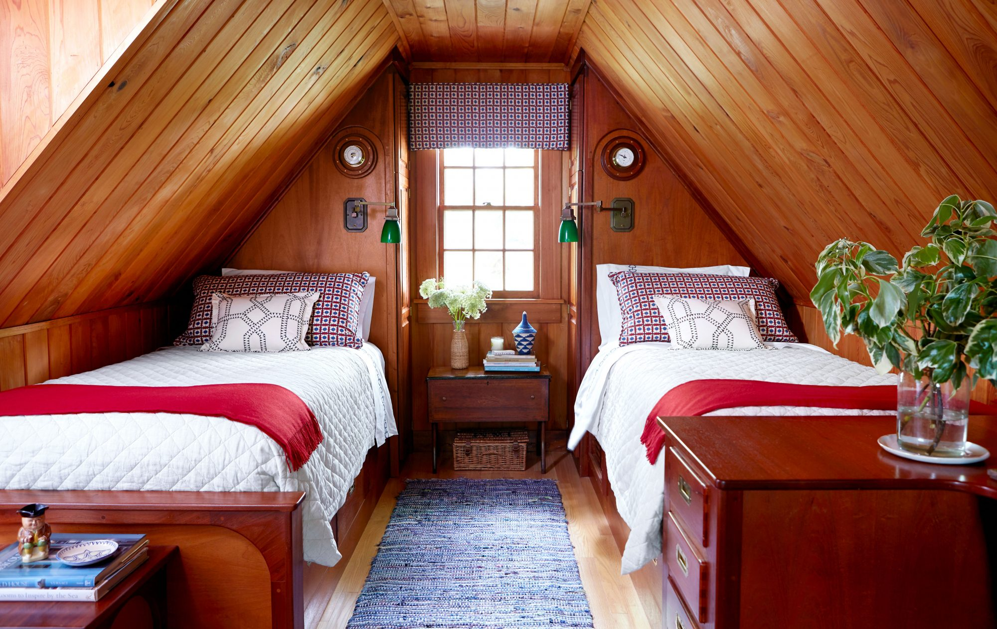 Wood-Clad Bedroom with Twin Beds and Red White and Blue Accents