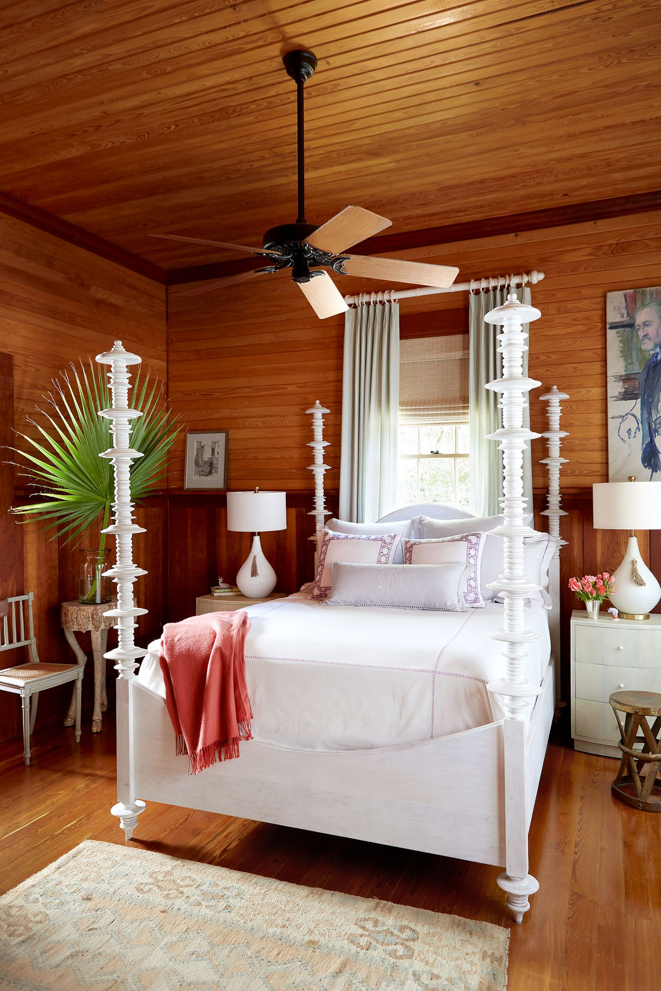 Wood-clad Master Bedroom with White Four-Poster Bed