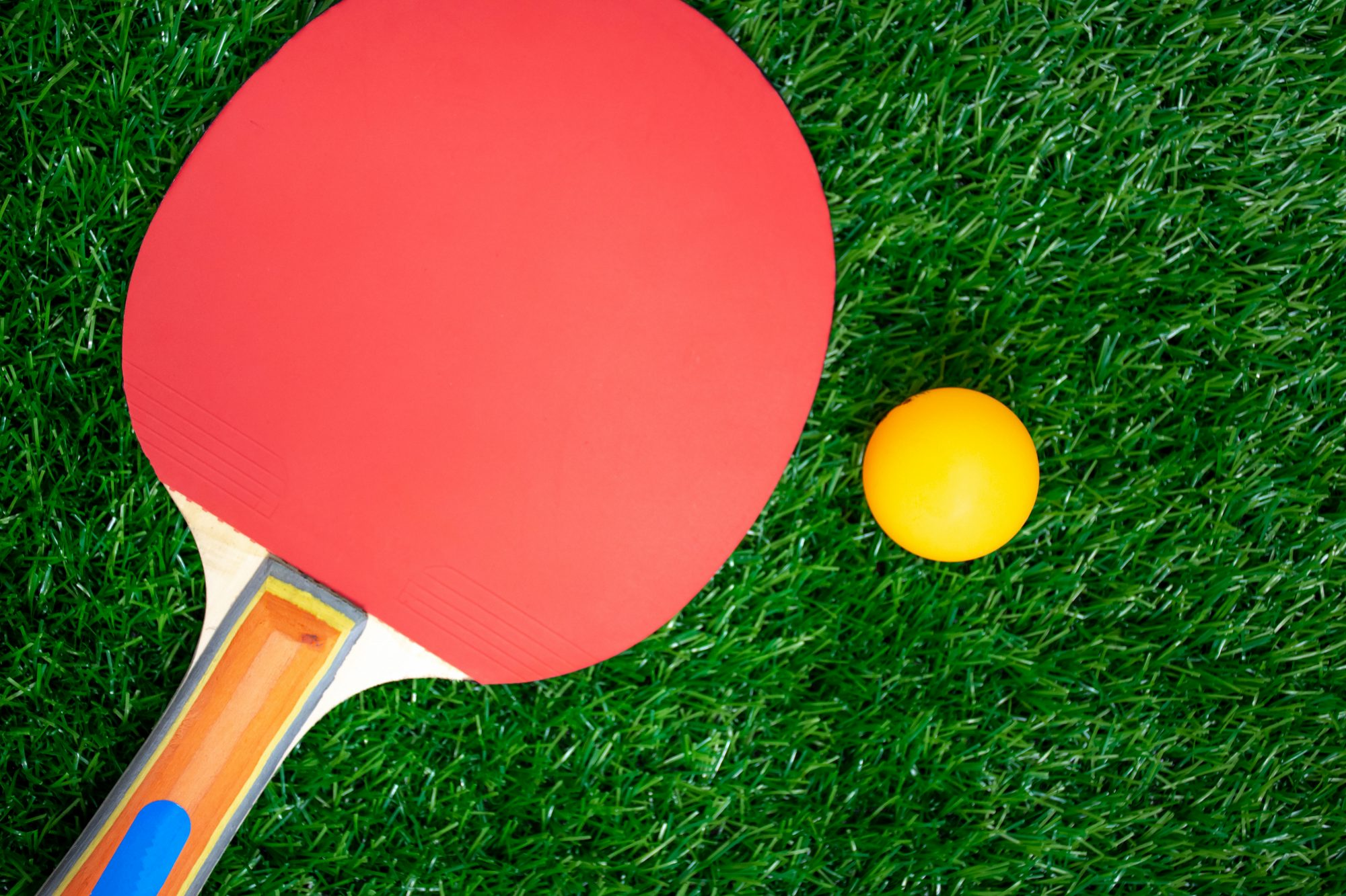 Table tennis racket with orange balls,Ping-Pong paddles on greensward