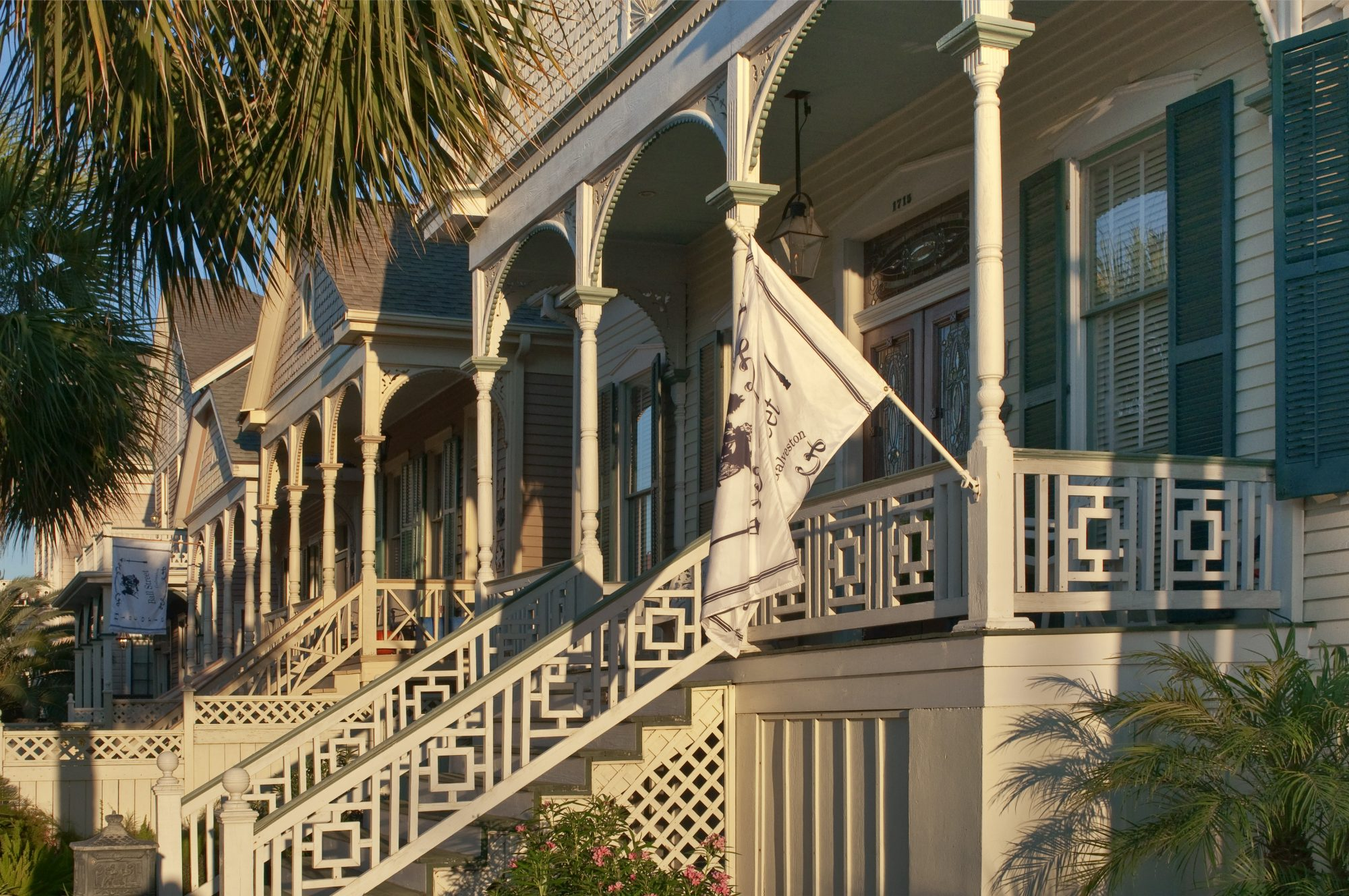 Strung along a narrow barrier island on the Gulf of Mexico, Galveston is a beautiful blend of graceful Victorian and early 20th-century mansions, bungalows, and cottages, along with a stunning historic downtown lined with tall palm trees and shady live oaks.