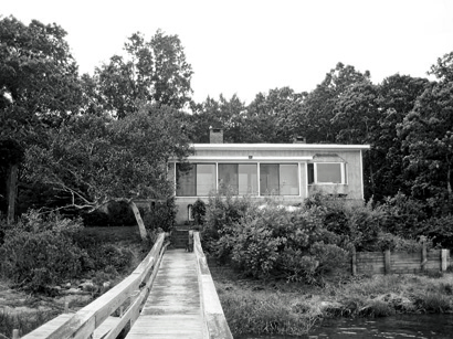 This squat Southampton, New York, tiny home sat too low and was too hidden behind vegetation to take advantage of its water views. Plus, its small footprint didn't jibe with the family's space needs.