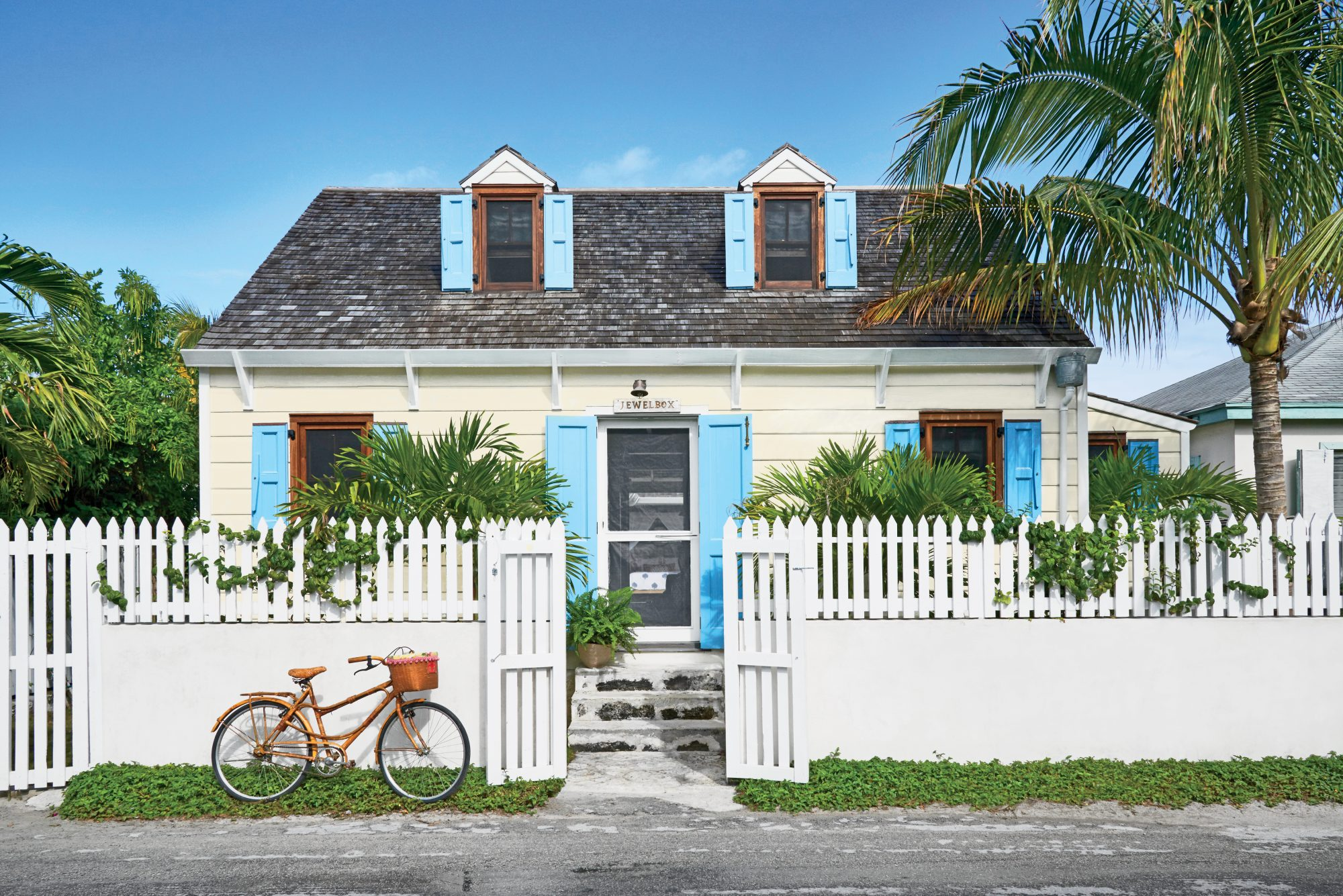 After careful restoration to keep its original integrity, this Harbour Island gem now exudes island style with its bright turquoise shutters, mahogany windows, and tropical landscaping.