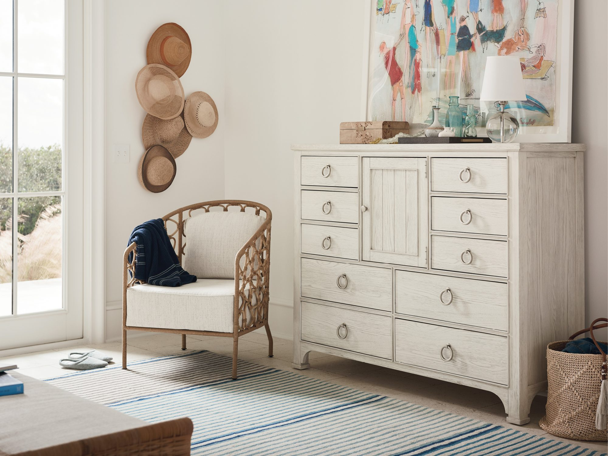 Pebble Accent Chair and Escape Dressing Chest from the Coastal Living Furniture Collection