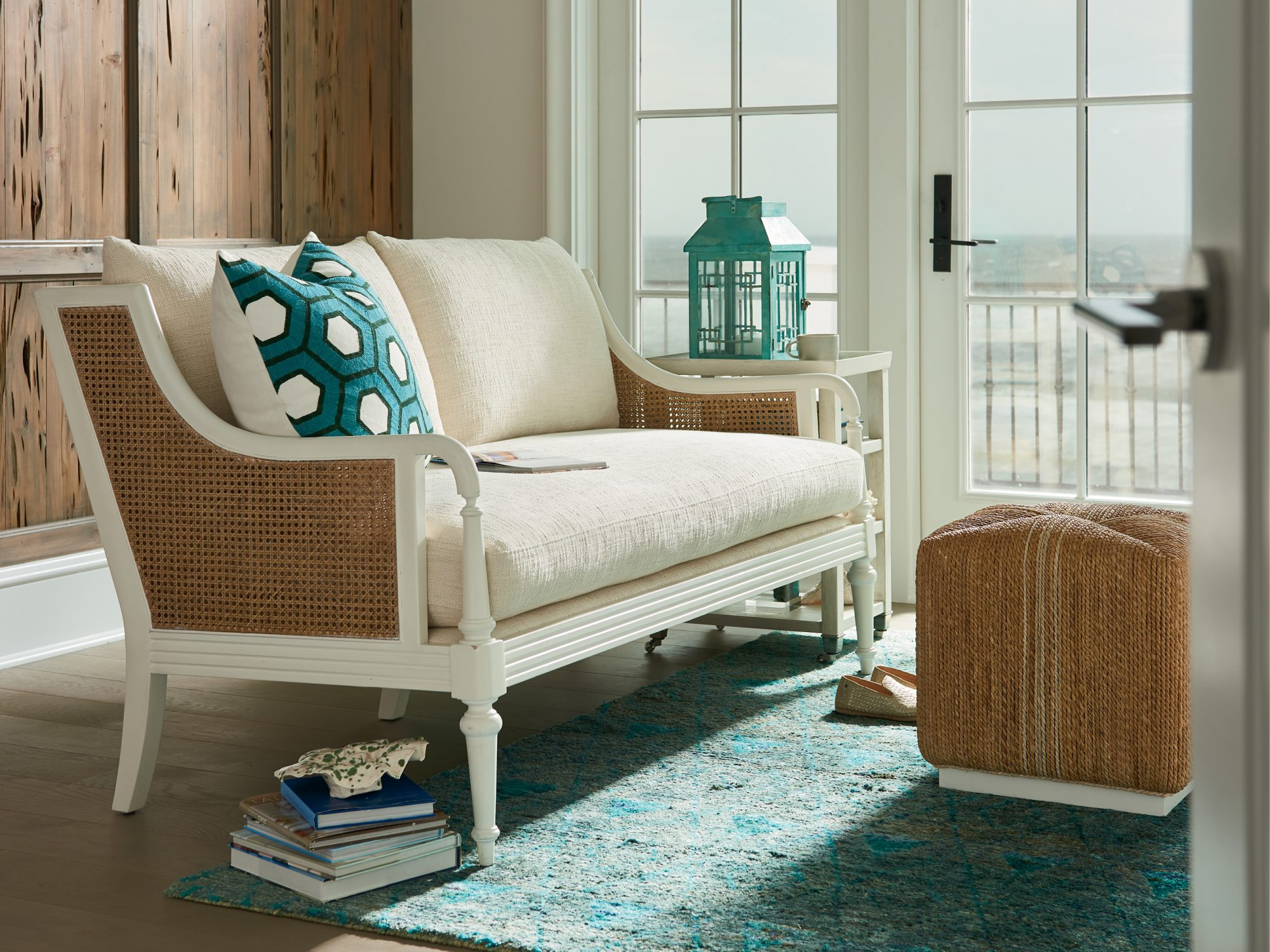 Stone Harbor Loveseat and Abaca Cube Ottoman from the Coastal Living Furniture Collection