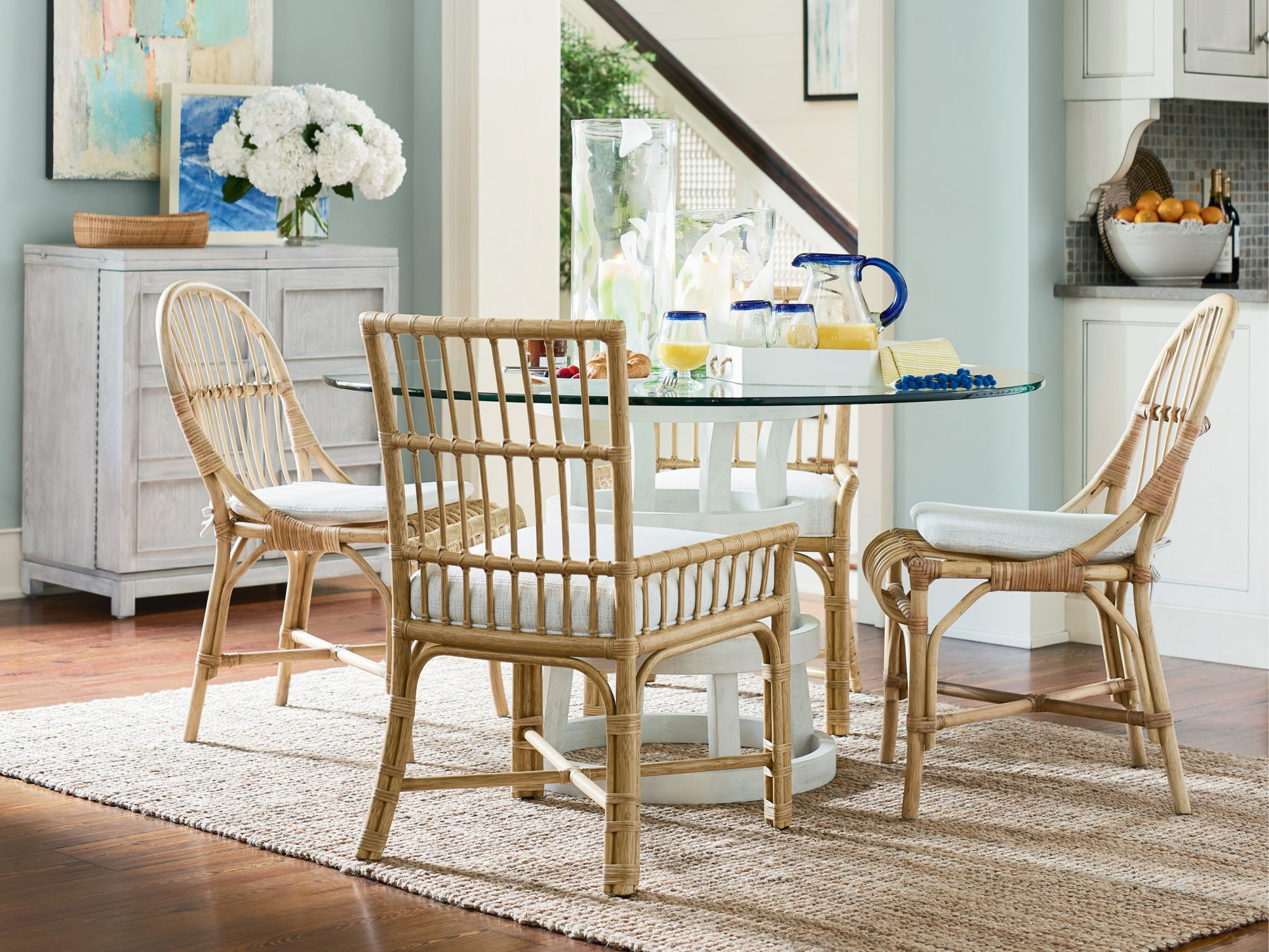 Rattan and Bamboo Accent Chairs and Glass-top Breakfast Nook Table from the Coastal Living Furniture Collection