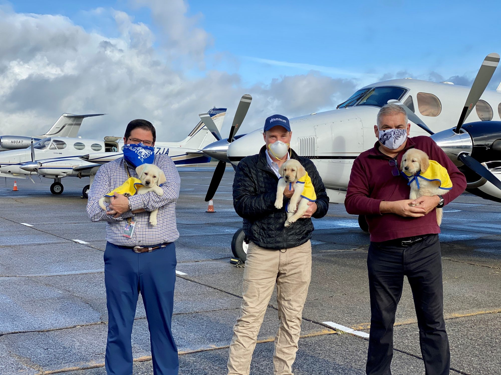 pilots with Canine Companions puppies (L-R - Josh Hochberg, Jeff Stewart, Martyn Lewis)