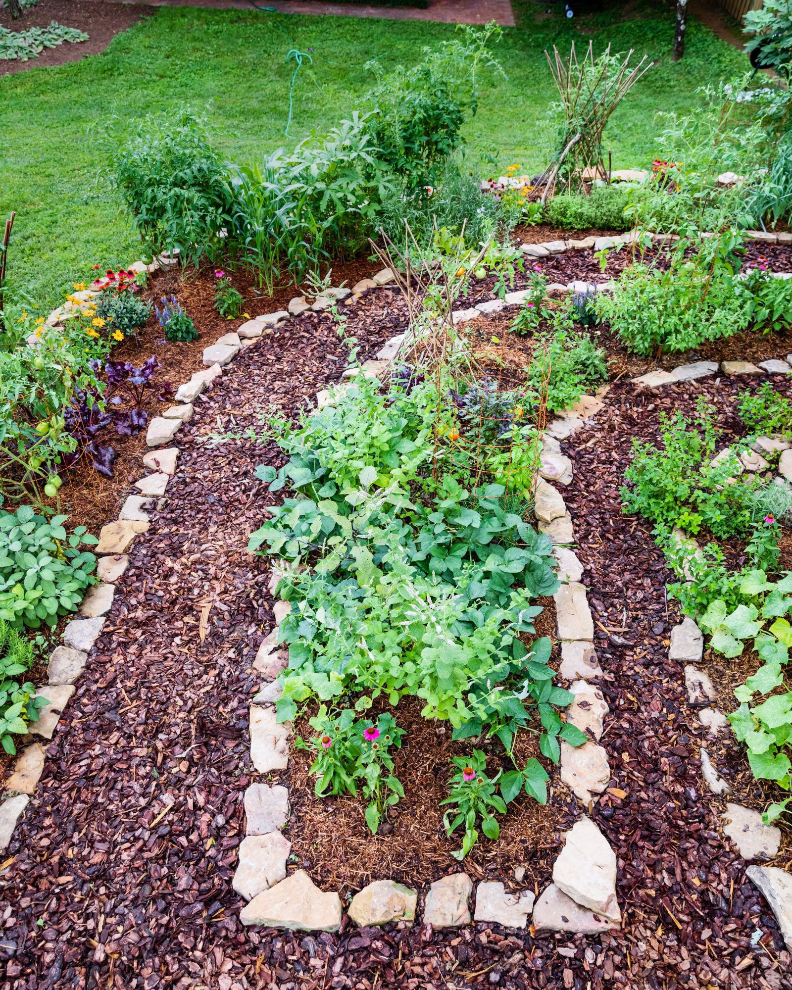 Rock and Mulch Lined Vegetable Garden Beds