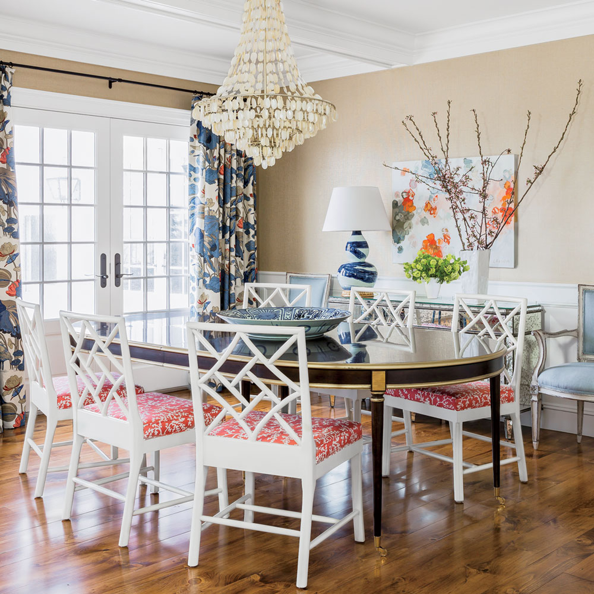 Bold patterns in striking blues and vivid corals pack a colorful punch in this dining room, which seamlessly blends super traditional pieces, like the stately table and mirrored console, with groovier pieces, like the Chippendale chairs and an artfully marbled lamp.                             Idea Spotlight                             Bring the beach inside. In this Cohasset, Massachusetts, dining room, a mother-of-pearl shell chandelier dresses down the room's more formal elements and connects the space to the Atlantic Ocean just steps from the house.