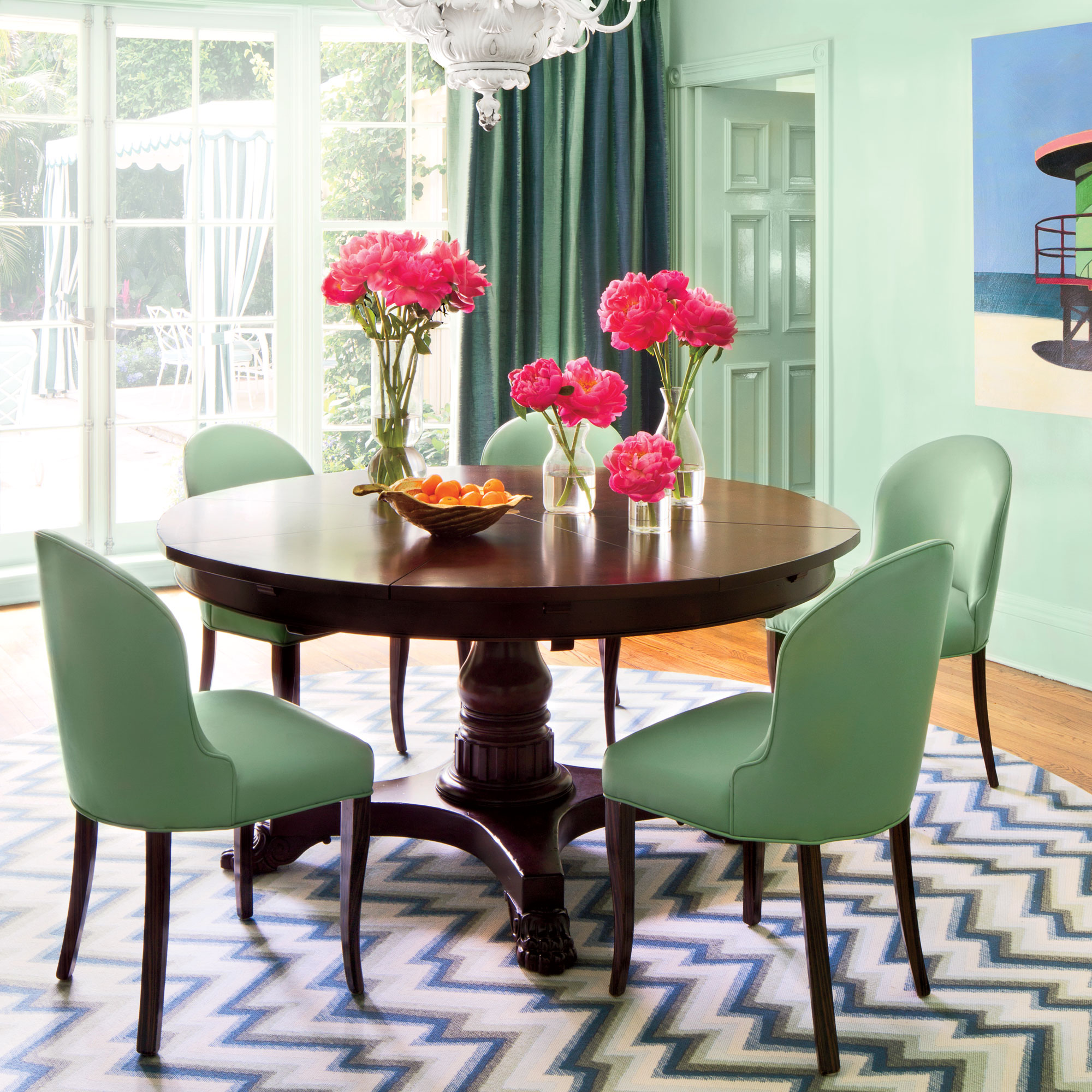 This retro-fresh room is convincing evidence that a monochrome palette makes a super bold statement. Go all out in various shades of one color; then choose a grounding piece, like a rug, to tie them all together in perfect harmony.                             Idea Spotlight                             Let a piece of art be your guide. This Palm Beach dining room takes its color cues from a painting of a lifeguard stand that the owners scooped up in Manhattan.