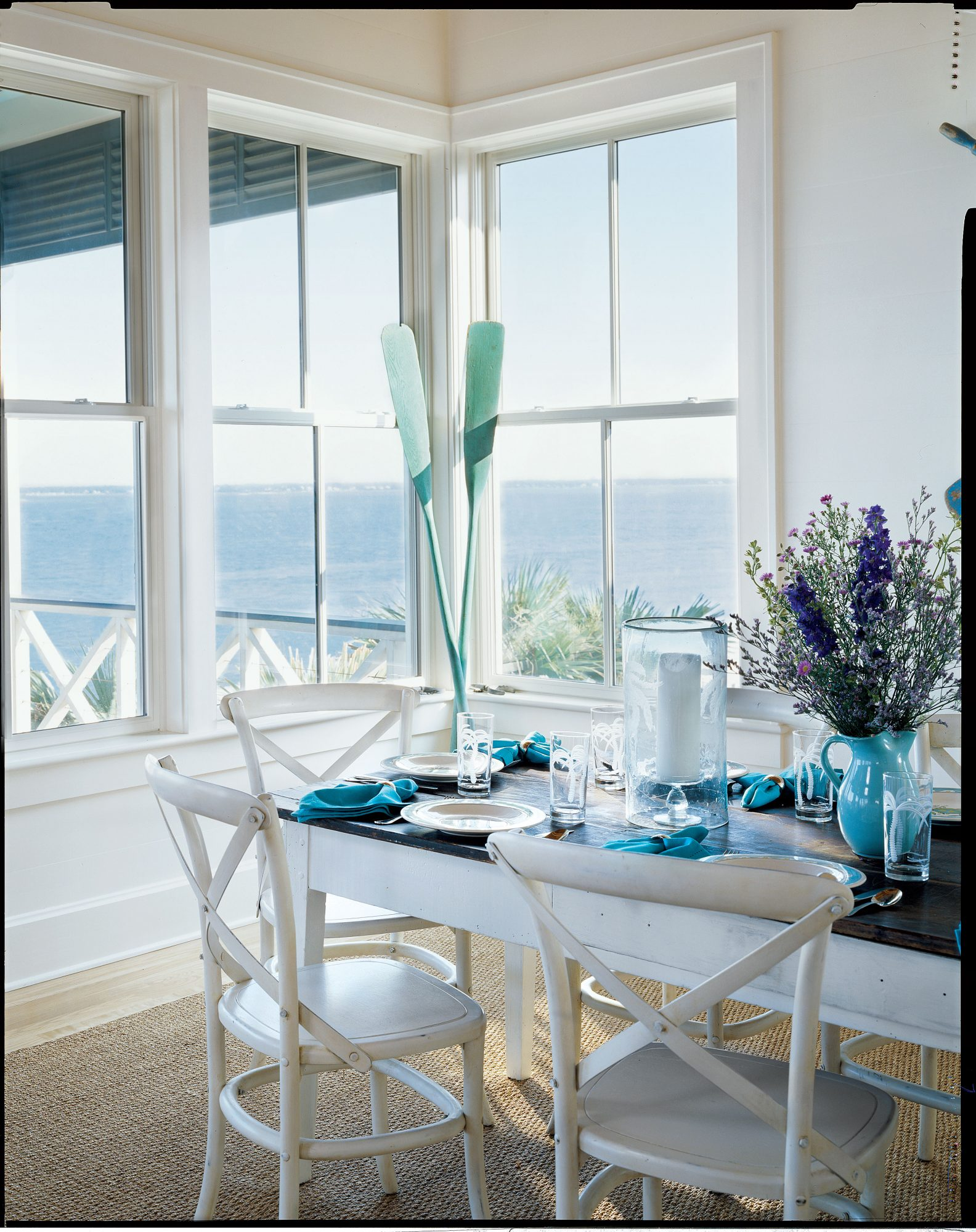 There's something serene about a white-on-white dining room. When you feel like adding color, try a splash of turquoise, such as this pair of paddles propped just so in the corner.                             Idea Spotlight                             Transform everyday objects into accents that become eye-catching works of art.