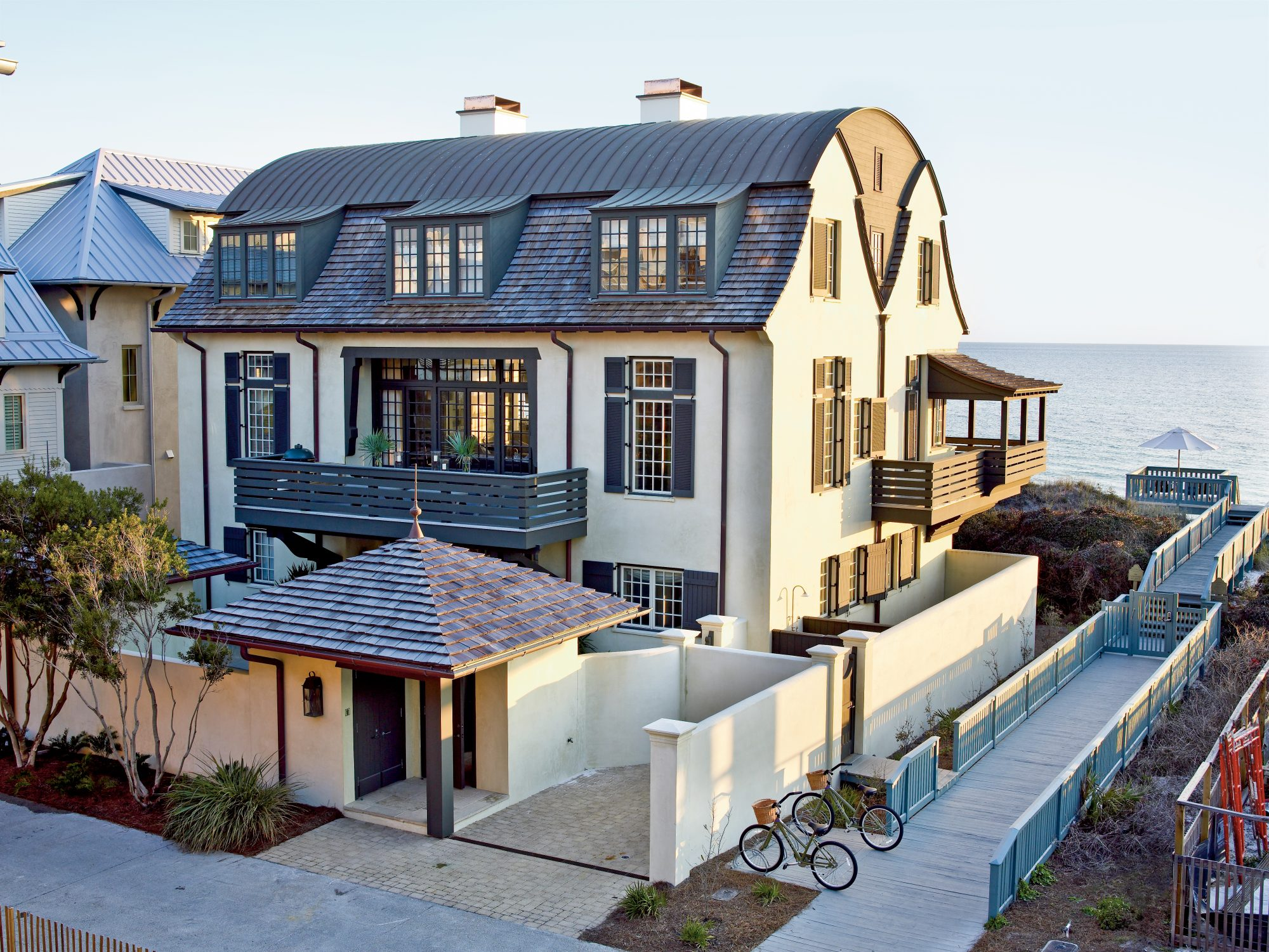 The Style: This three-level, Dutch Colonial take on a sea captain's home is a reminder that designing a beach house isn't always about overt references to the shore. Sometimes it's just about harnessing those soothing emotions that the ocean evokes.