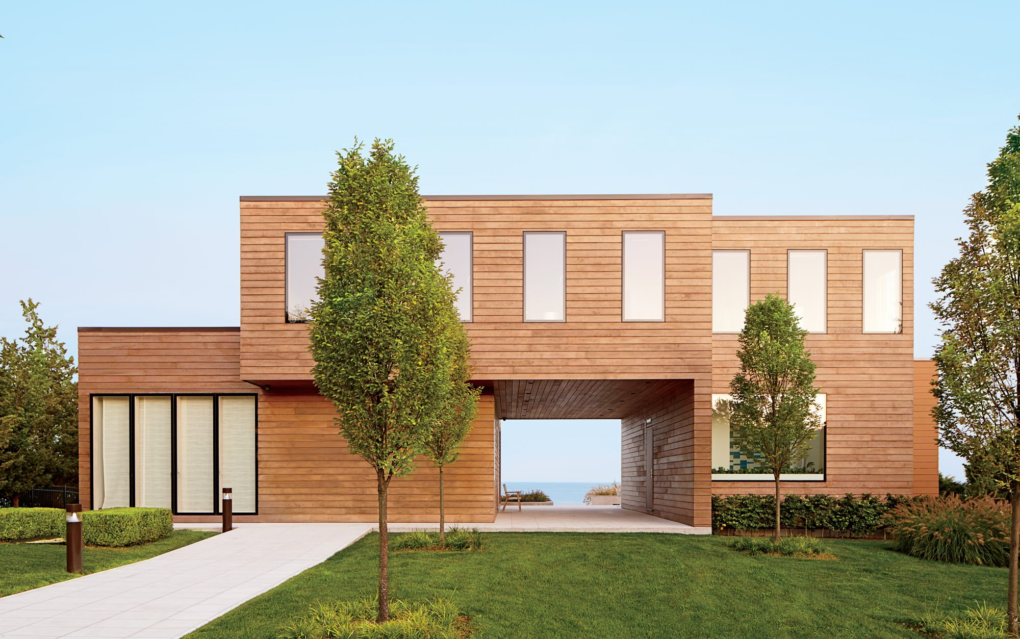 The Style: The contemporary, red cedar home's facade offers a glimpse of Long Island Sound through a deep breezeway paved with honed Jerusalem limestone.