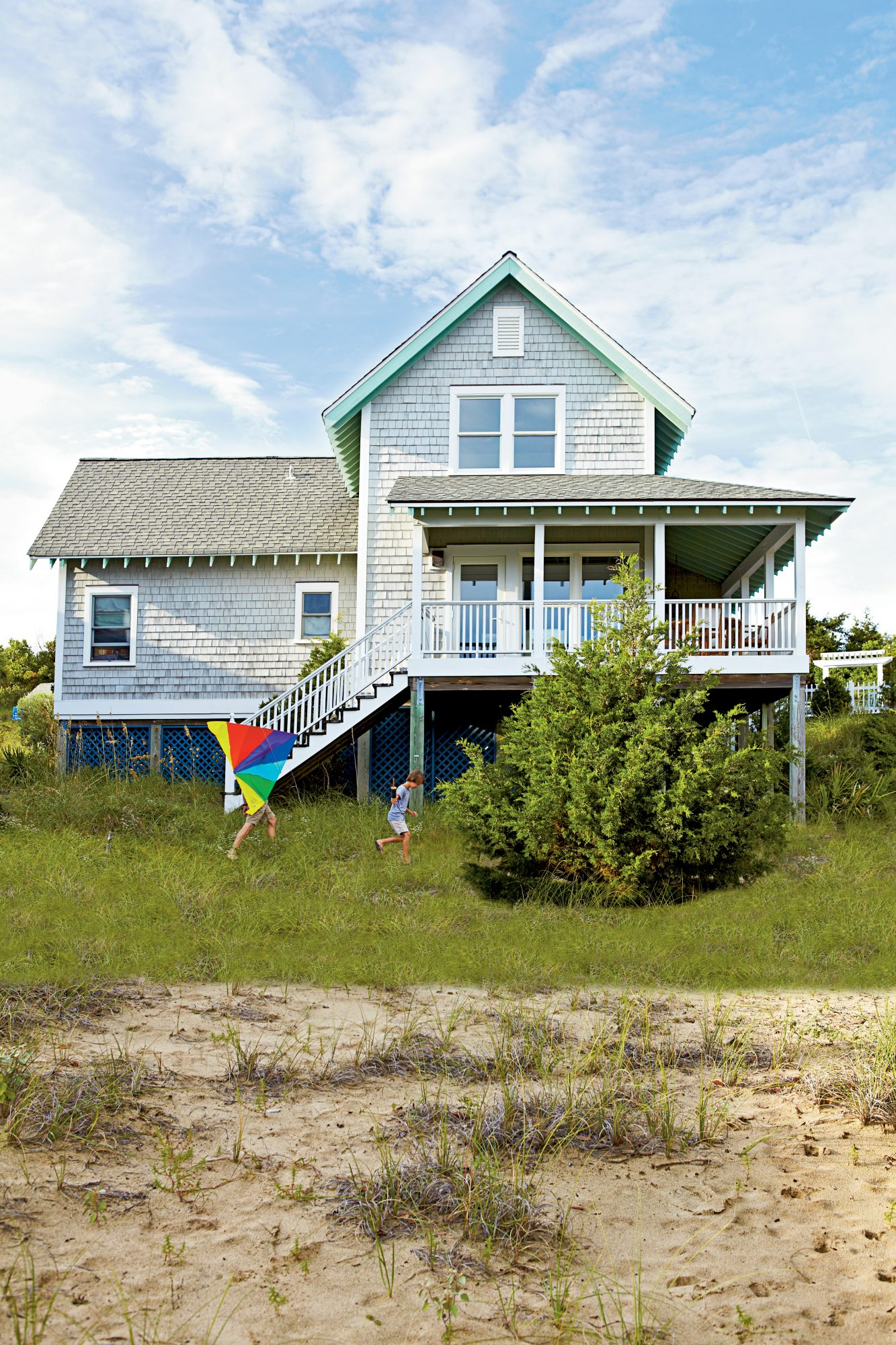 The Style: This simple, shingled bungalow off the coast of Southport, North Carolina, features soft gray cedar shakes and a large wraparound porch acts as an outdoor room.