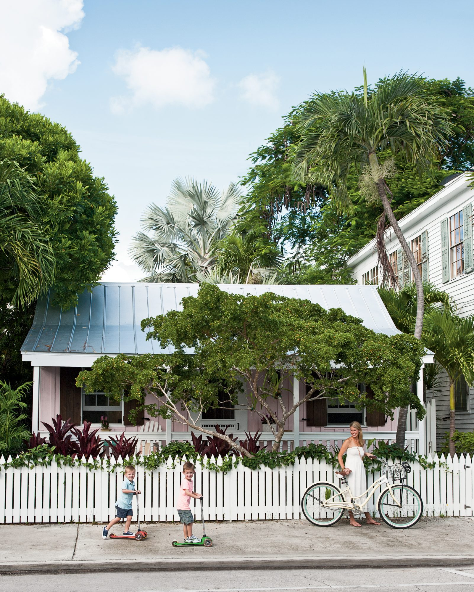 The Style: This 800-square-foot, 19th-century cottage in Key West's Old Town neighborhood is as classic as they come, with a low-slung tin roof, front porch, and white picket fence.