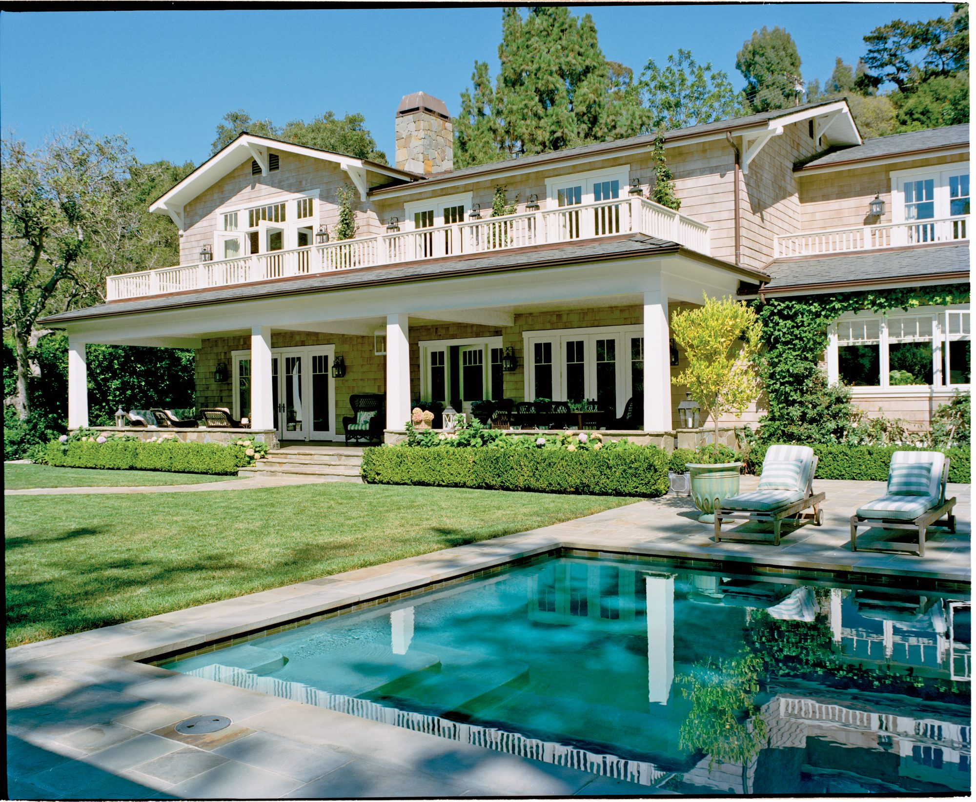 The Style: Nestled in the rolling hills of Pacific Palisades, a tony Los Angeles enclave on the ocean, this shingle-style house is the perfect marriage of East and West—coasts, that is. With a wide front porch, tons of wicker, and plenty of antiques, the