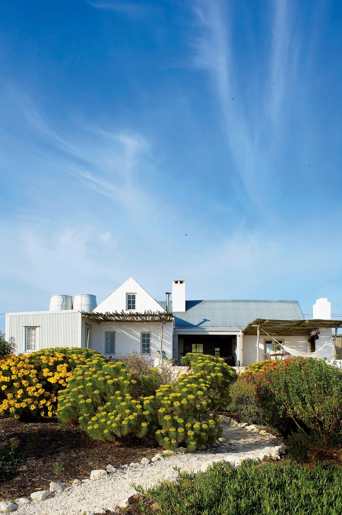 "The Style: Despite being only four years old, this cement beach cottage in Churchhaven, South Africa, boasts a nostalgic appeal that's perfect for its idyllic location. ""We really wanted to achieve the feel of a house from a bygone age,"" explains Helen Un"