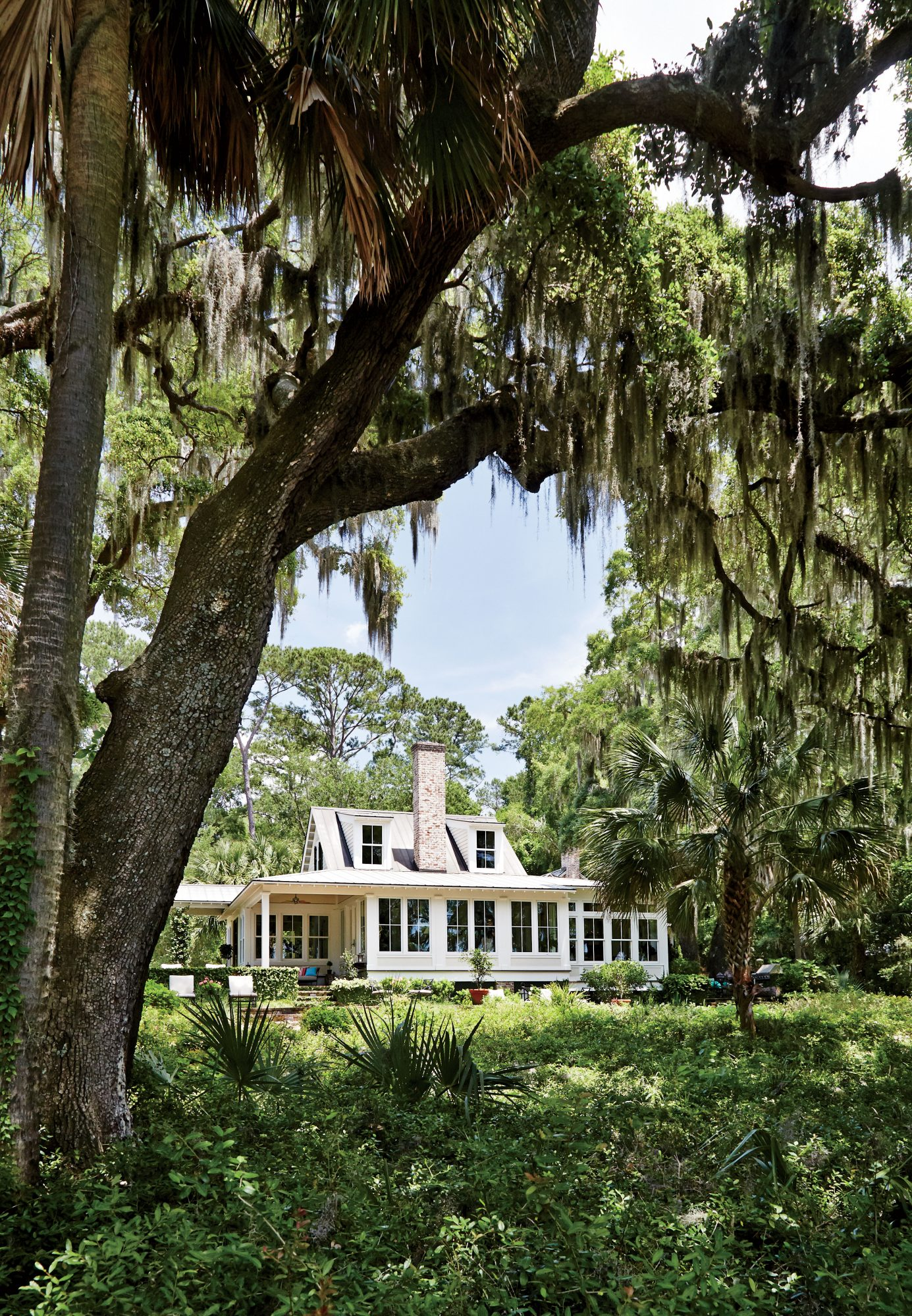 "On the shaded shore of Spring Island (a former cotton plantation) where the winding Colleton River empties into the Atlantic. ""We knew the relationship to the water was the most important element,"" says architectural designer James Strickland."