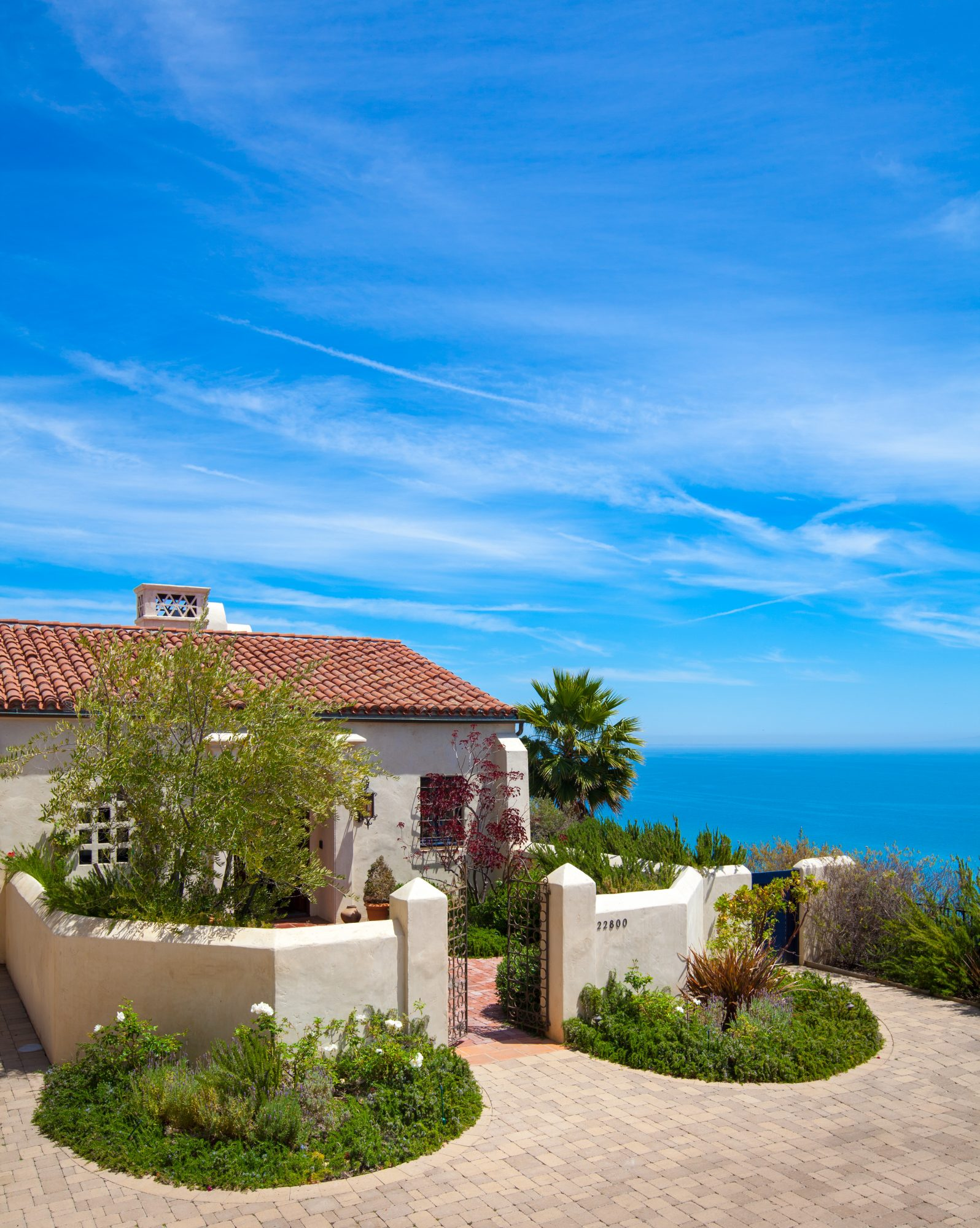 "In California, the land of invention, even old styles can live in new ways. Los Angeles architect Lewin Wertheimer chose Spanish Colonial influences for a house standing alone on a tawny hillside 300 feet above the beach. Nothing says ""old California"" lik"