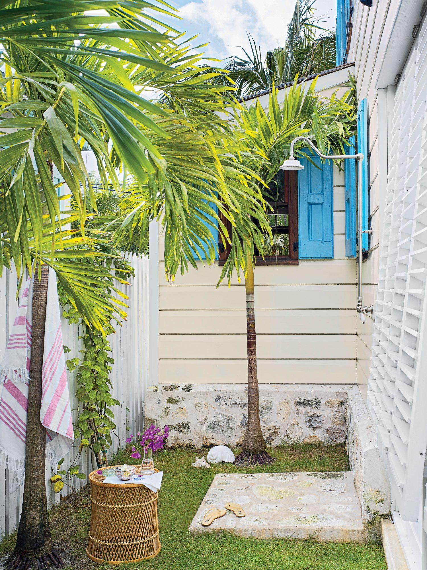 This Harbour Island, Bahamas, cottage was on the verge of collapse after years of neglect. Homeowner Trish Becker outfitted the side of the house, now enclosed by a privacy fence, with an outdoor shower. The foundation wall and shower floor were crafted u