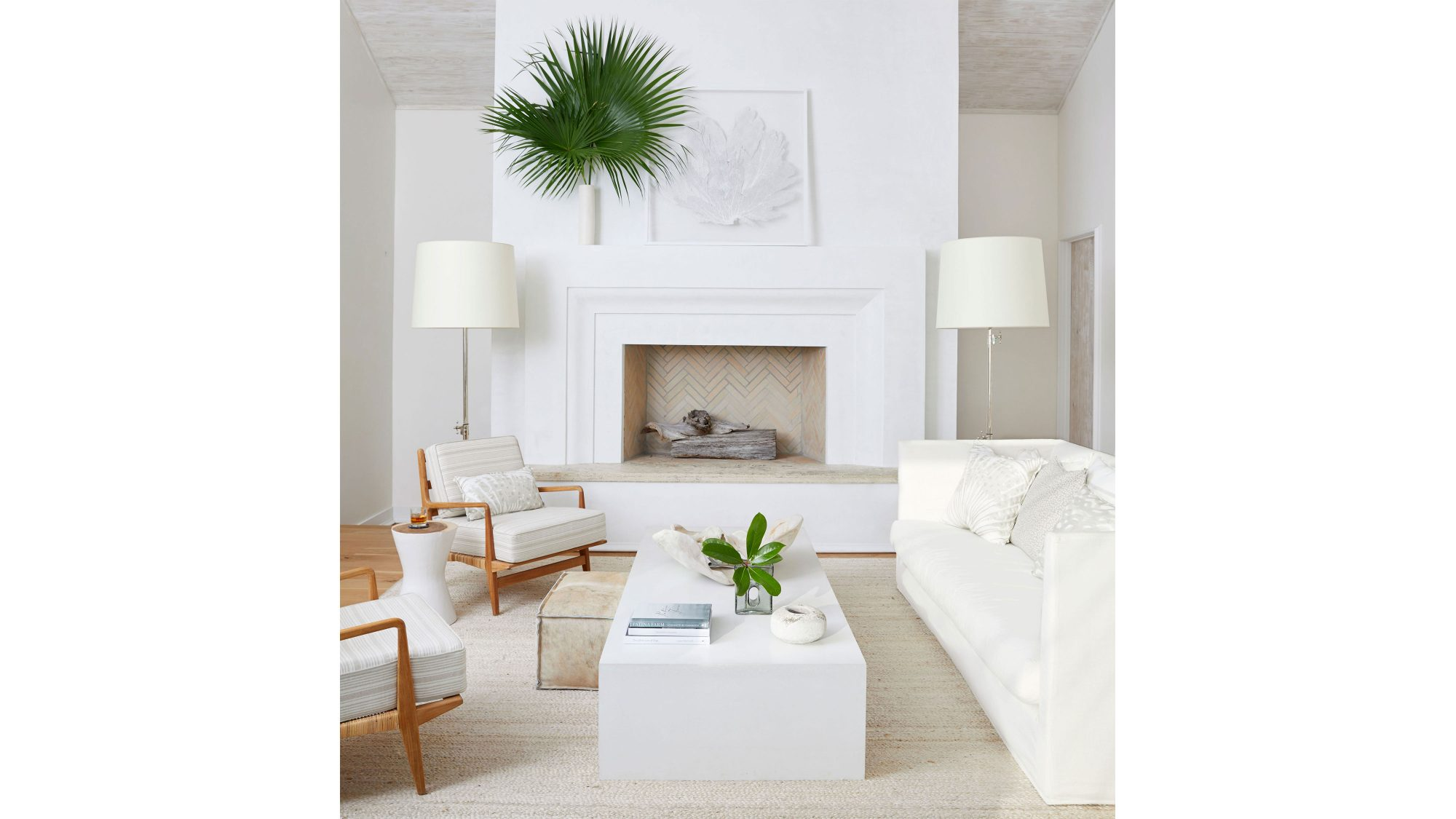 An all-white living room mantel